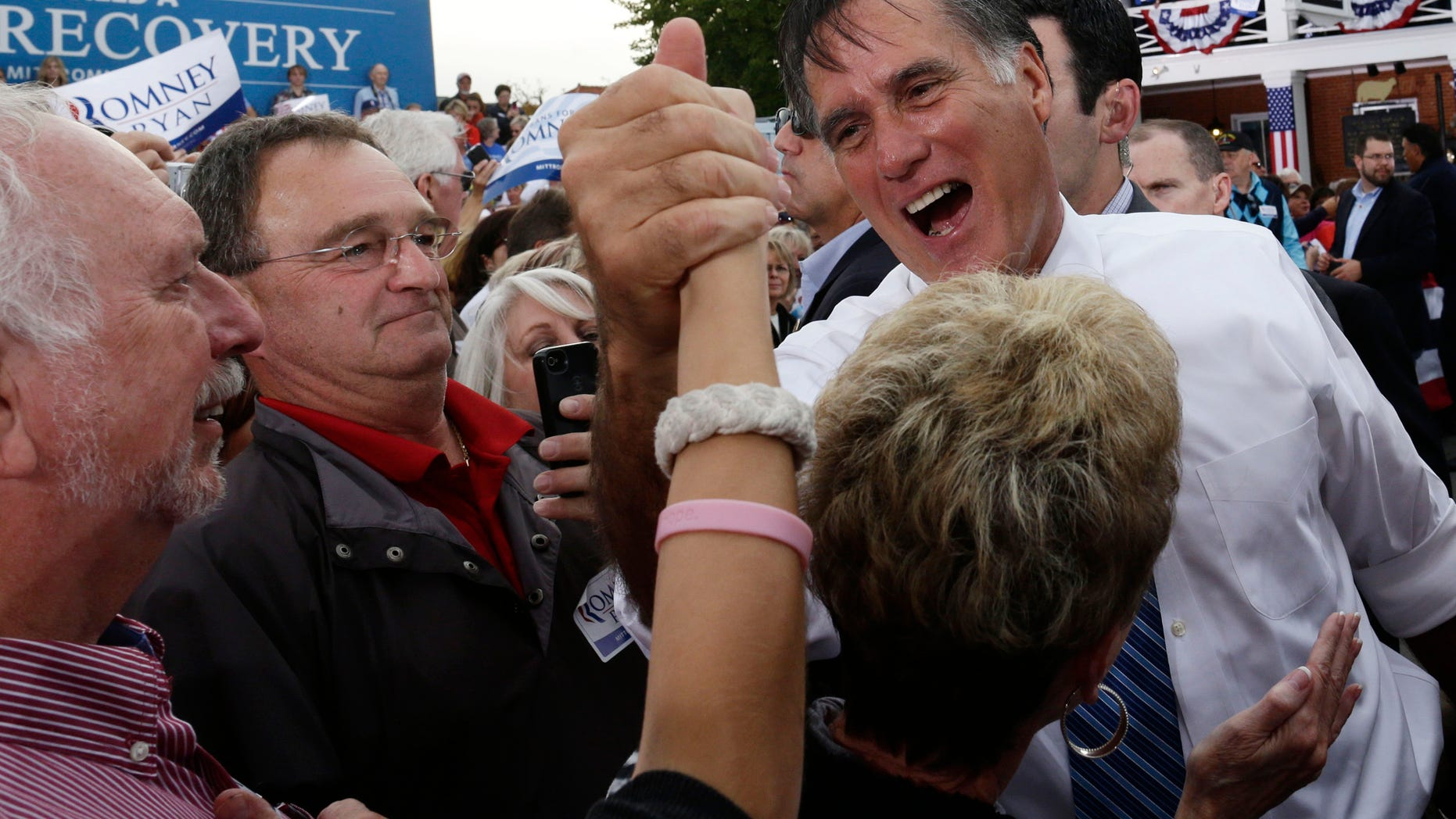 Saturday, Oct. 13, 2012: Mitt Romney campaigns in front of the Golden Lamb Inn and Restaurant in Lebanon, Ohio.