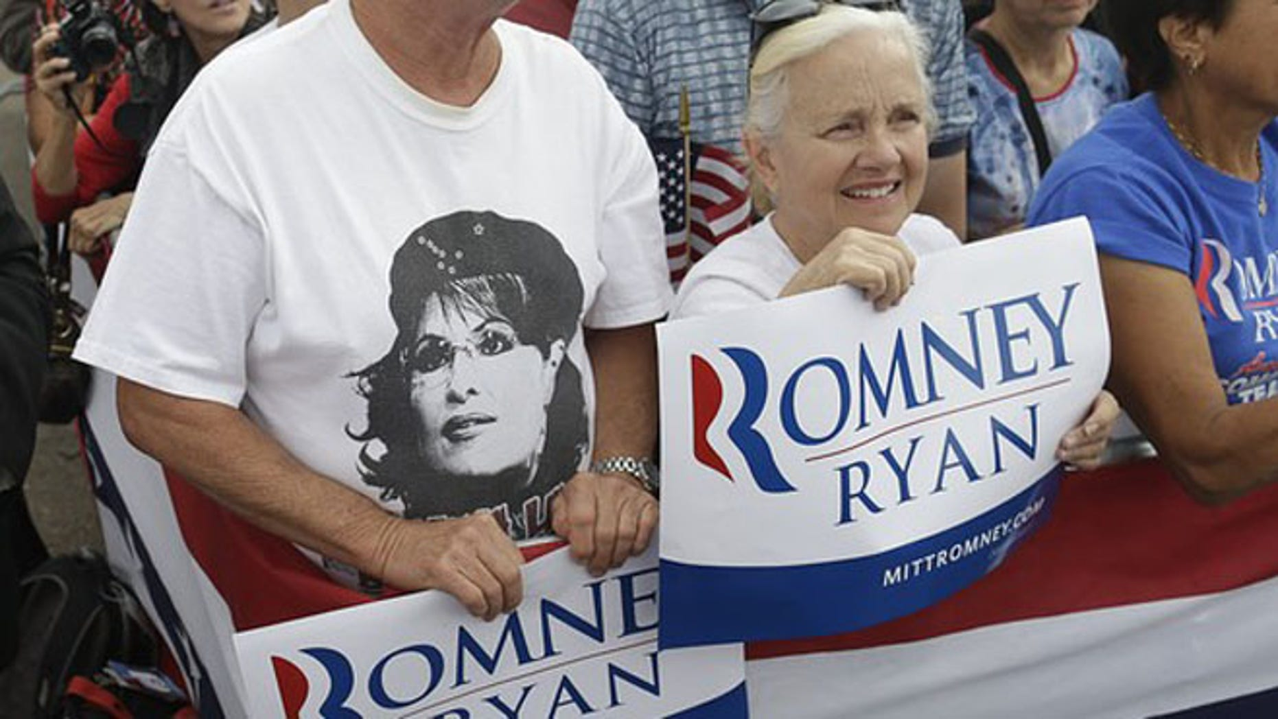 FILE: Sept. 24, 2012: The image of Sarah Palin is seen on a T-shirt as Mitt Romney campaigns in Pueblo, Colo.