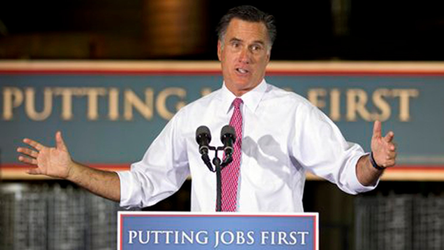 June 14, 2012: GOP presidential candidate Mitt Romney gestures during a campaign stop at Seilkop Industries in Cincinnati, Ohio.