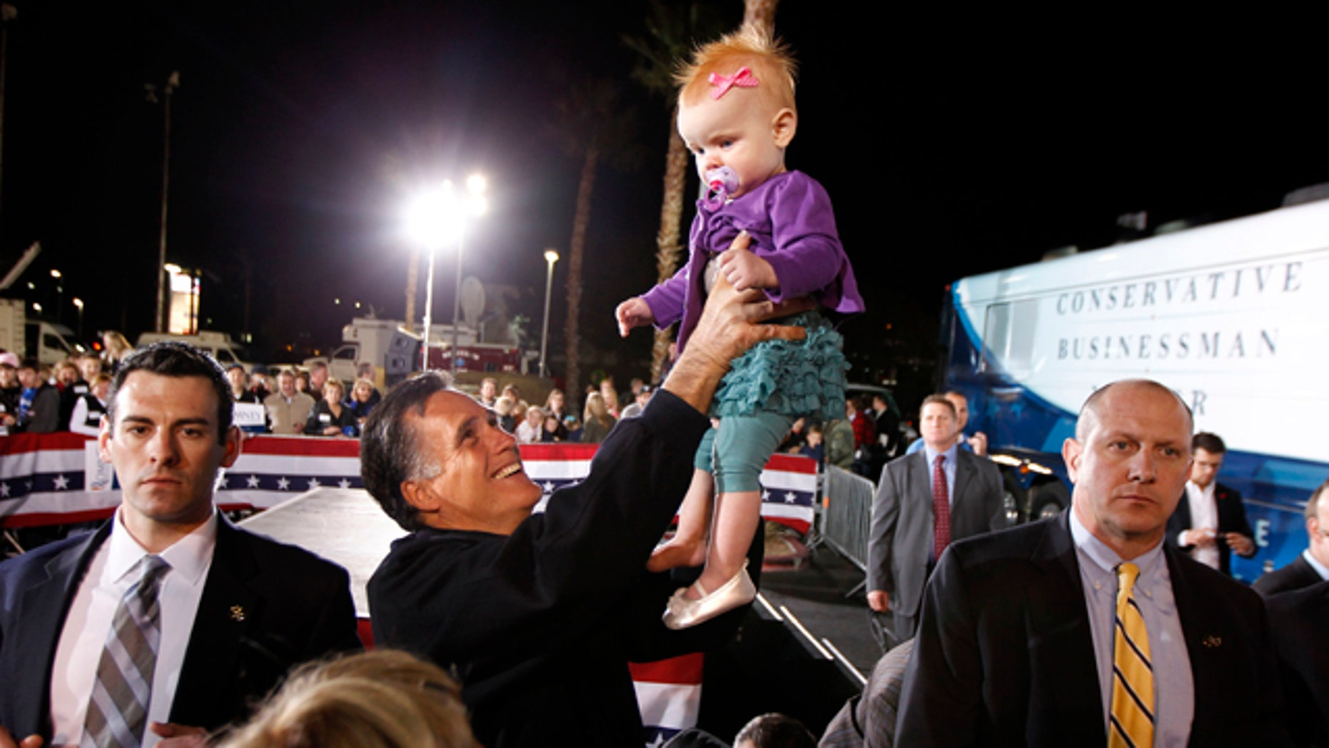 Feb. 3: Mitt Romney holds up 9-month-old Eve Smith, of Las Vegas, at a campaign rally in Henderson, Nev.