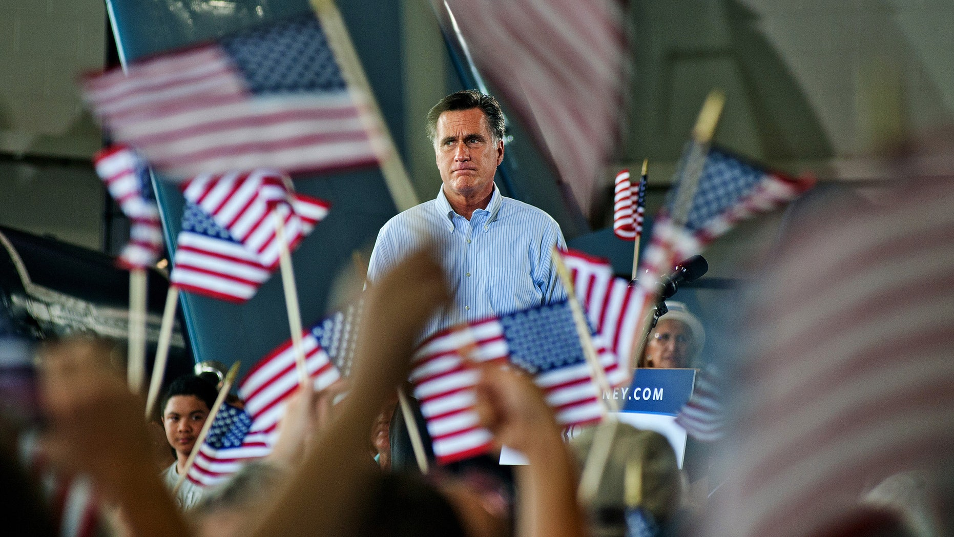 Saturday, Sept. 8, 2012: Mitt Romney addresses the audience at a rally with the GOP team at the Military Aviation Museum in Virginia Beach, Va.