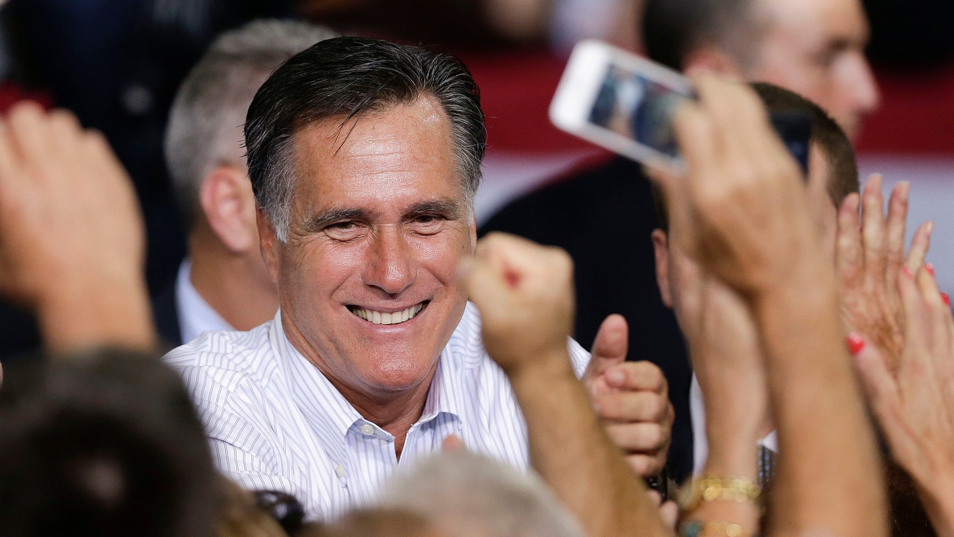 FILE: Sept. 21, 2012: Mitt Romney greets supporters after speaking at a rally Friday  in Las Vegas.