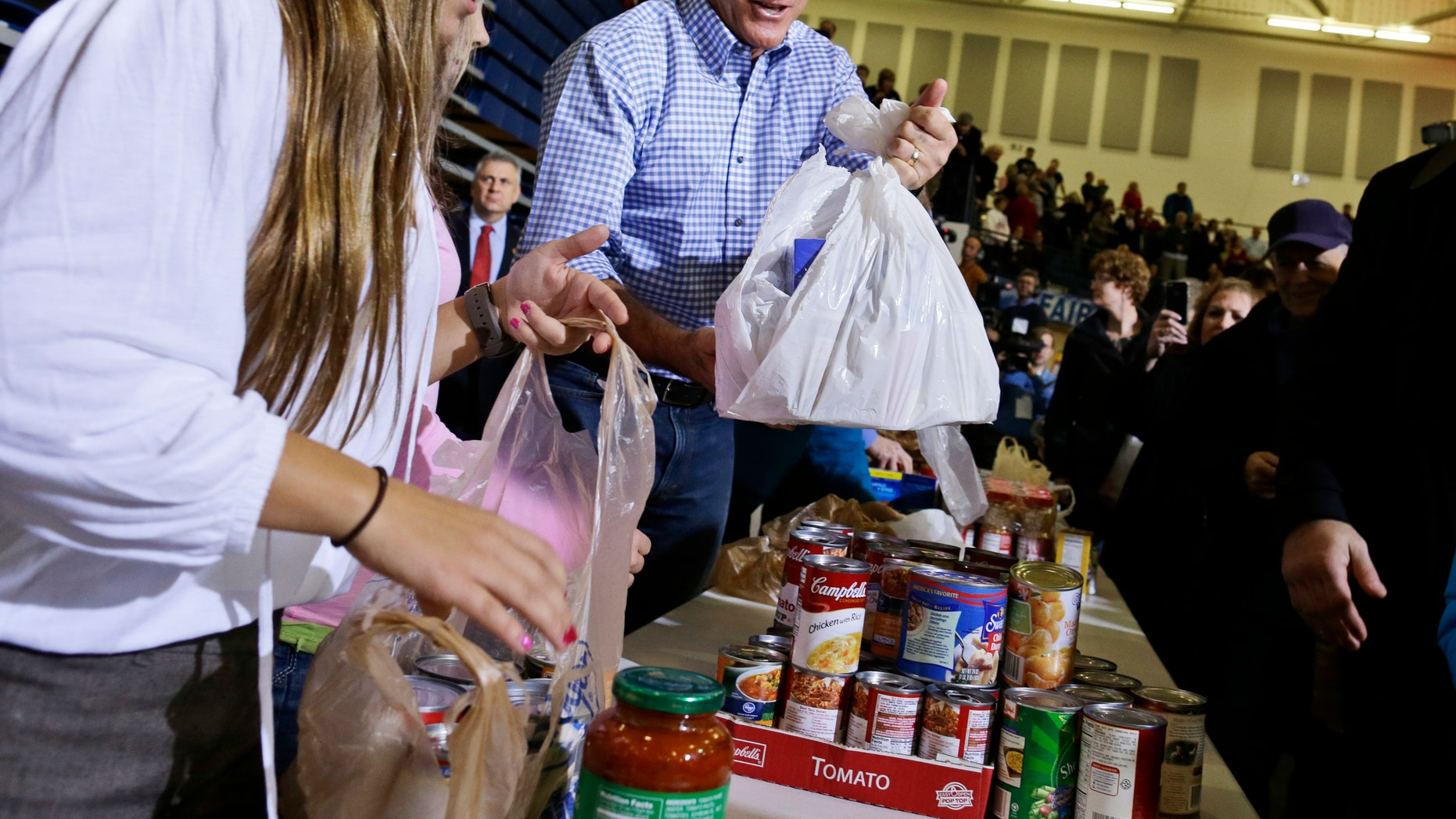 Tuesday, Oct. 30, 2012: Mitt Romney participates in an event to collect supplies for victims of superstorm Sandy, in Kettering, Ohio.