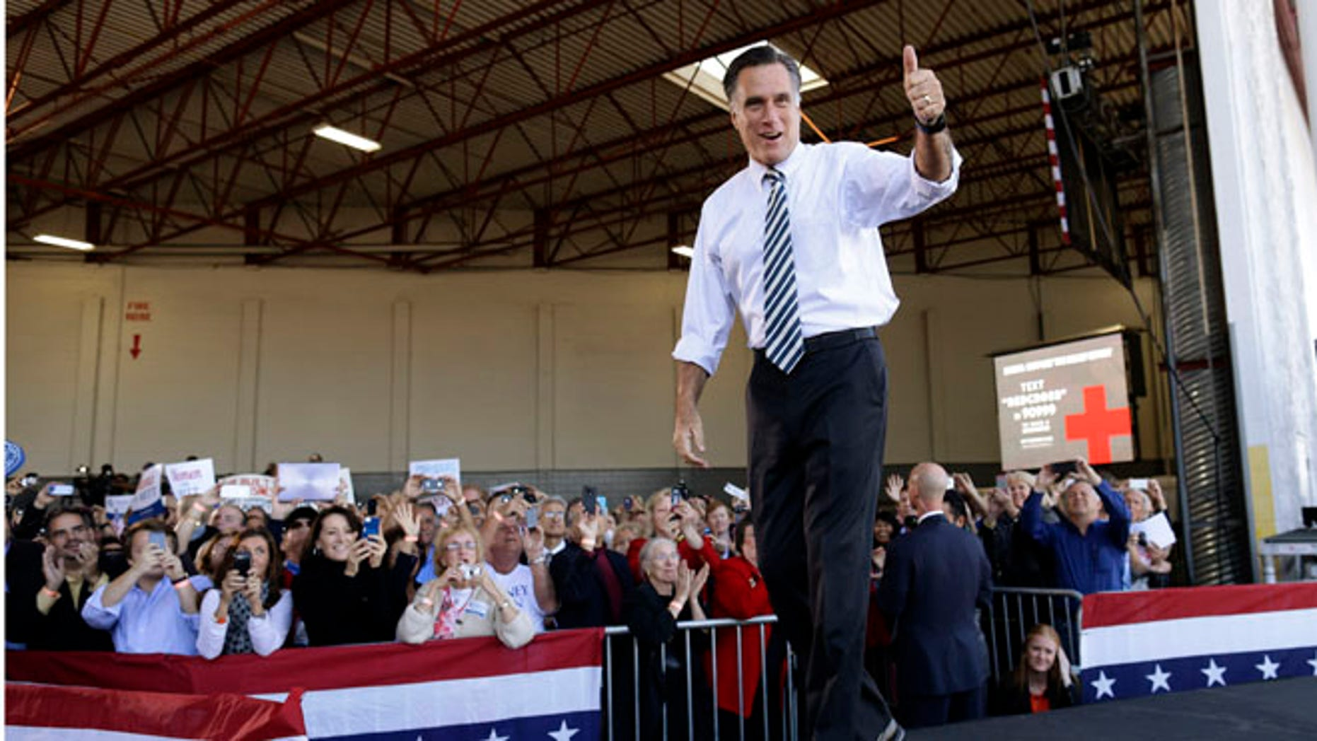 Wednesday, Oct. 31, 2012: Mitt Romney arrives at a campaign stop in Tampa, Fla.