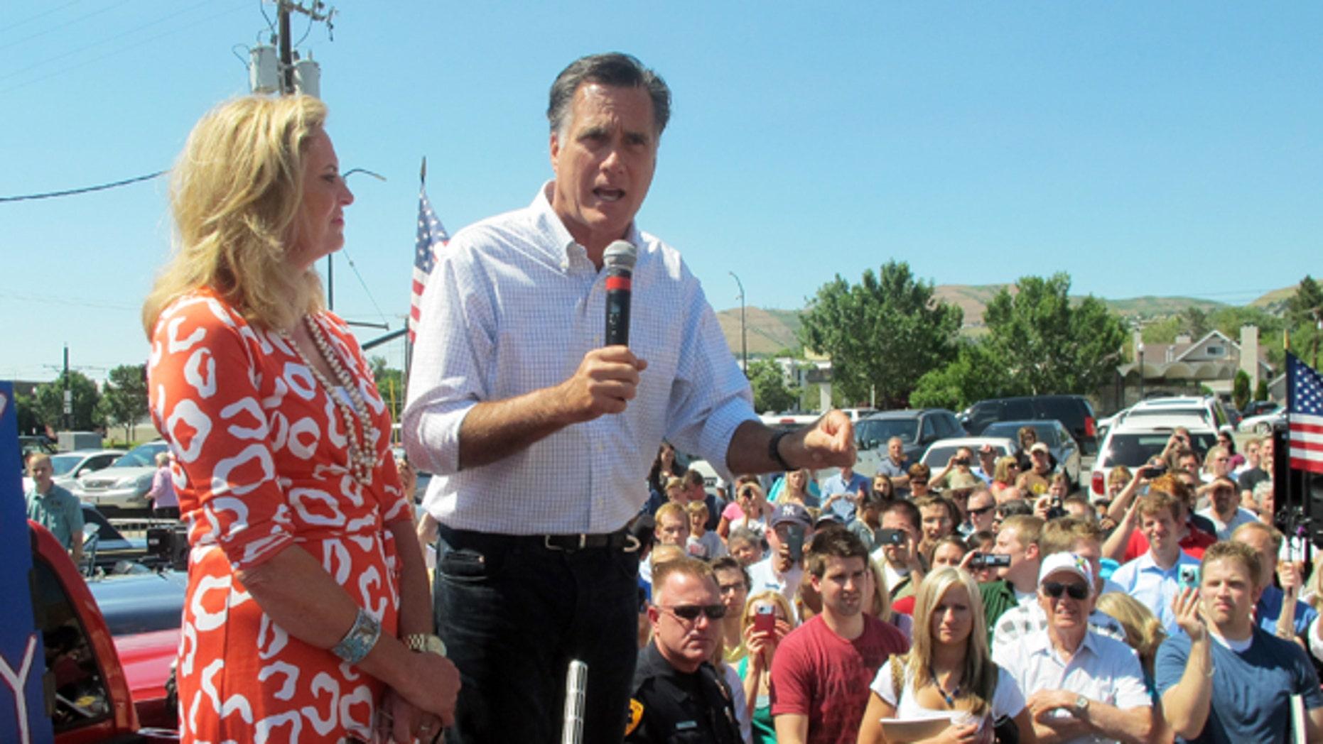 June 24: Former Massachusetts Gov. Mitt Romney and his wife, Ann, greet supporters at a drive-in hamburger restaurant in Salt Lake City.