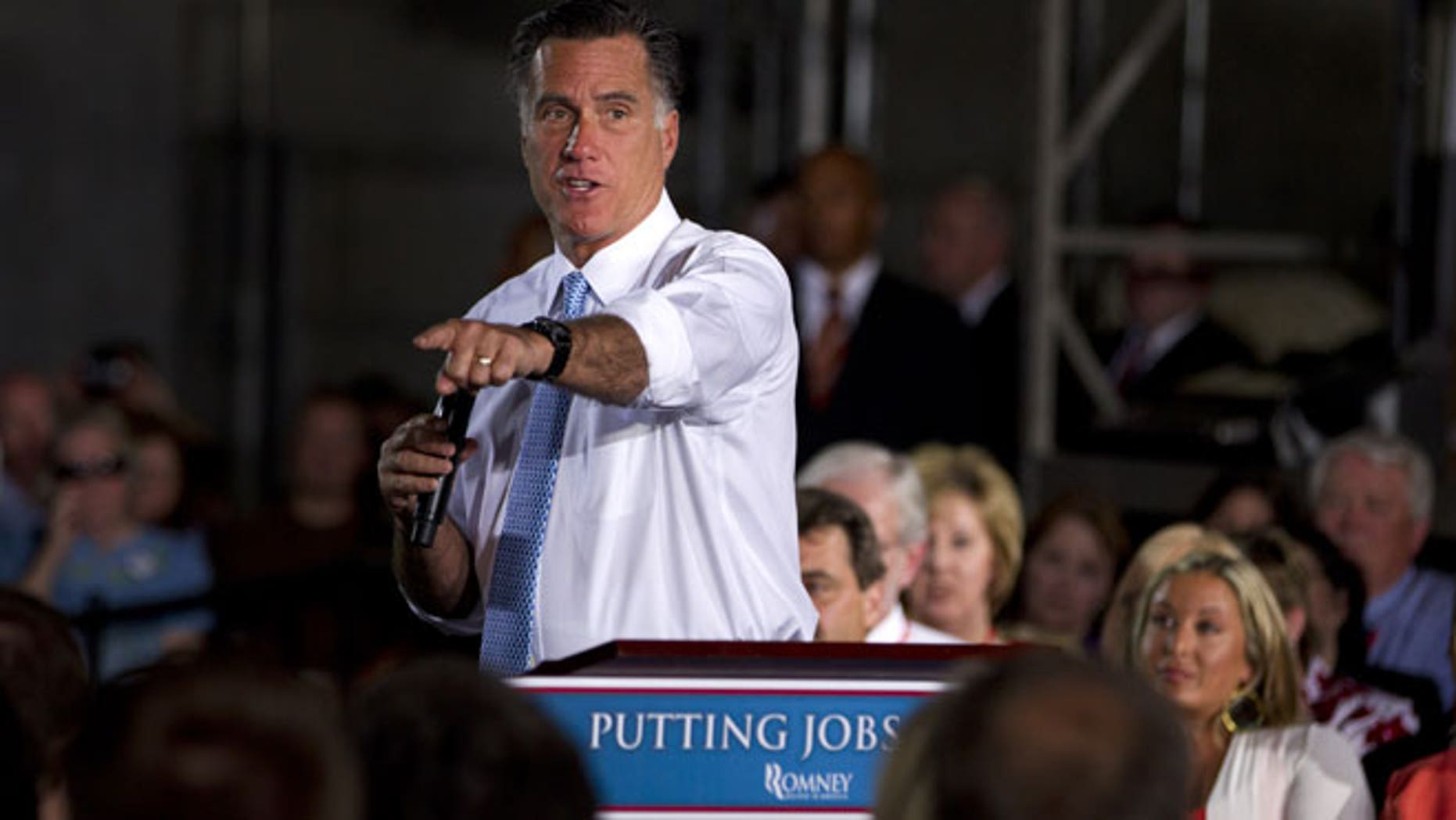 June 5, 2012: Republican presidential candidate, former Massachusetts Gov. Mitt Romney gestures during a campaign stop at Southwest Office Systems, in Fort Worth, Texas.