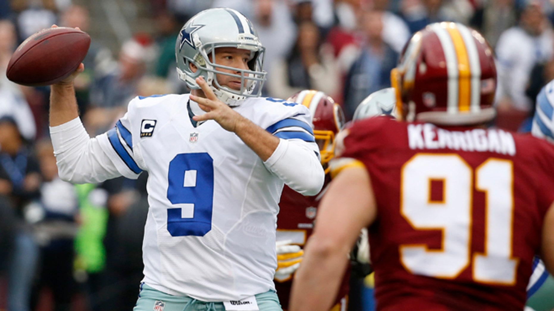 Dallas Cowboys quarterback Tony Romo (9) passes the ball during the first half of an NFL football game against the Washington Redskins in Landover, Md., Sunday, Dec. 28, 2014. (AP Photo/Alex Brandon)