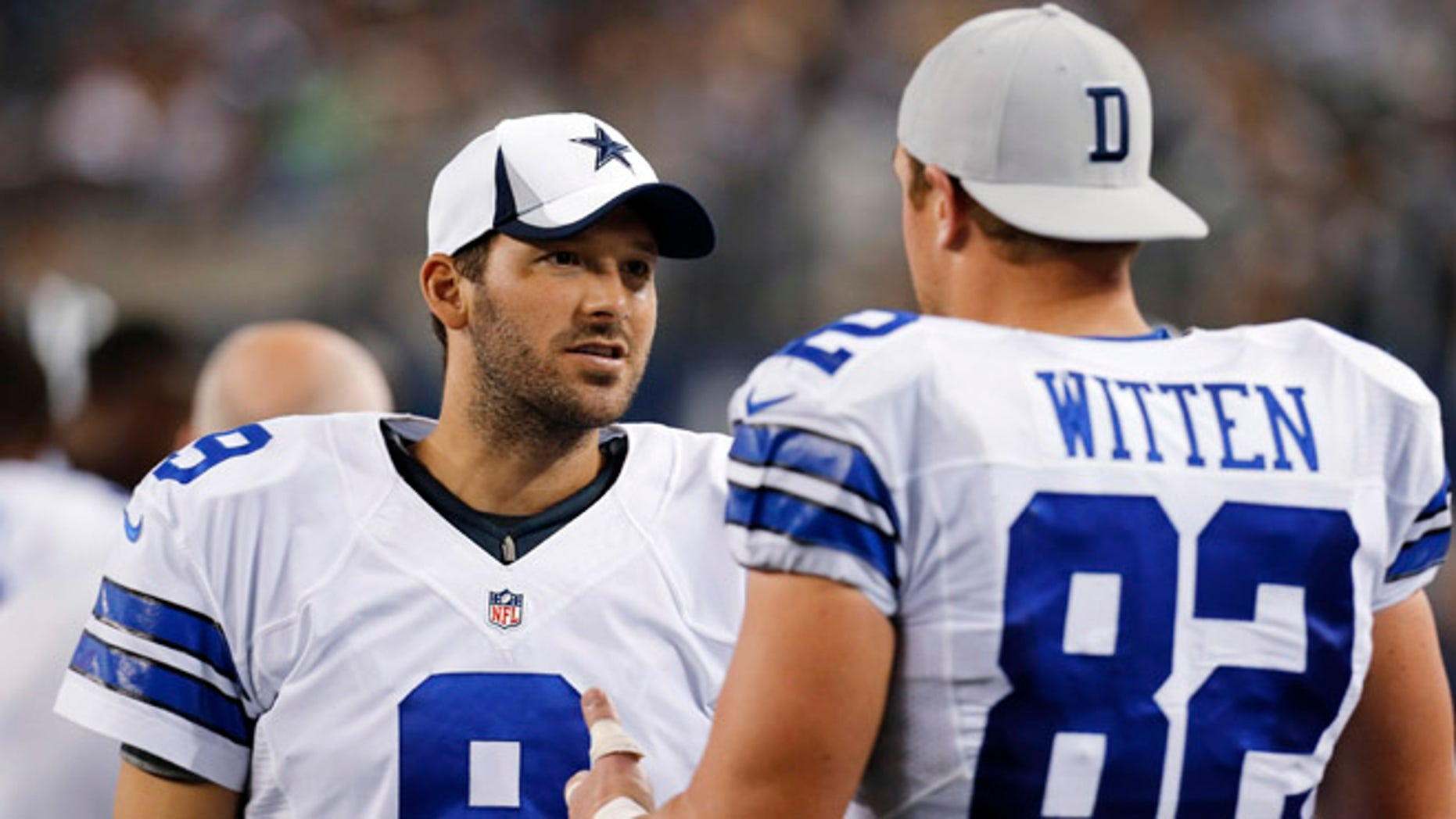 FILE -  In this Saturday, Aug. 24, 2013 file photo, Dallas Cowboys quarterback Tony Romo (9) and tight end Jason Witten (82) talk on the sideline during the second half of a preseason NFL football game against the Cincinnati Bengals,in Arlington, Texas. Quarterback Tony Romo is hurt again, and his favorite tight end is here to tell you the Cowboys can make it work without him, Tuesday, Aug. 30, 2016. (AP Photo/Sharon Ellman, File)