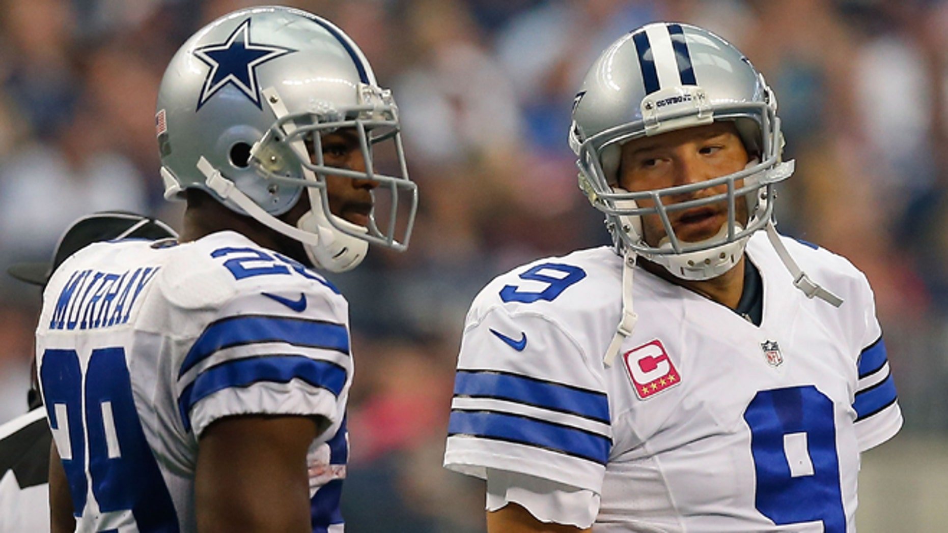 ARLINGTON, TX - OCTOBER 05:  Tony Romo #9 of the Dallas Cowboys talks to DeMarco Murray #29 of the Dallas Cowboys against the Houston Texans in the first half at AT&T Stadium on October 5, 2014 in Arlington, Texas.  (Photo by Tom Pennington/Getty Images)
