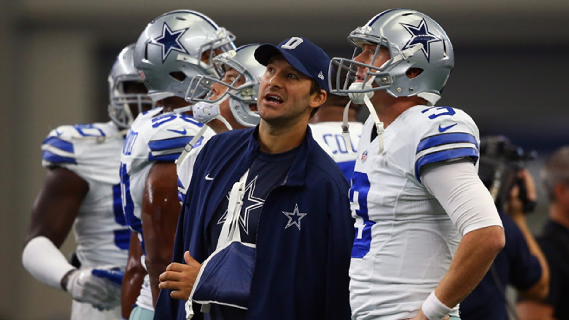 ARLINGTON, TX - SEPTEMBER 27:  (L-R) Tony Romo #9 of the Dallas Cowboys talks with  Brandon Weeden #3 before a game against the Atlanta Falcons at AT&T Stadium on September 27, 2015 in Arlington, Texas.  (Photo by Ronald Martinez/Getty Images)