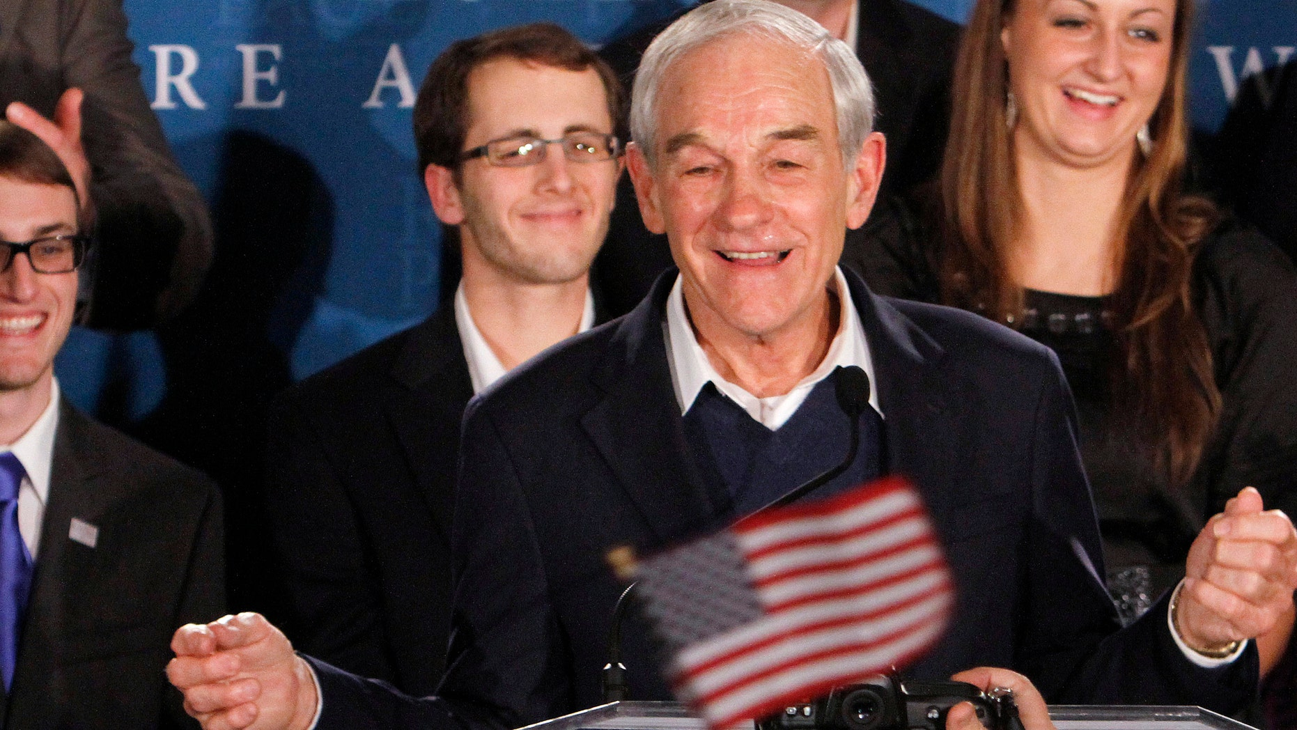 Republican presidential candidate, Rep. Ron Paul, R-Texas, speaks to supporters during an election night really in Manchester, N.H., Tuesday, Jan. 10, 2012.  (AP Photo/Bill Sikes)