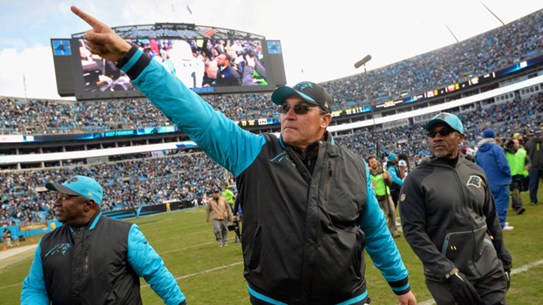 Head coach Ron Rivera of the Carolina Panthers salutes the crowd after defeating the Seattle Seahawks 31-24 at the NFC Divisional Playoff Game at Bank of America Stadium on January 17, 2016 in Charlotte, North Carolina.  (Photo by Grant Halverson/Getty Images)
