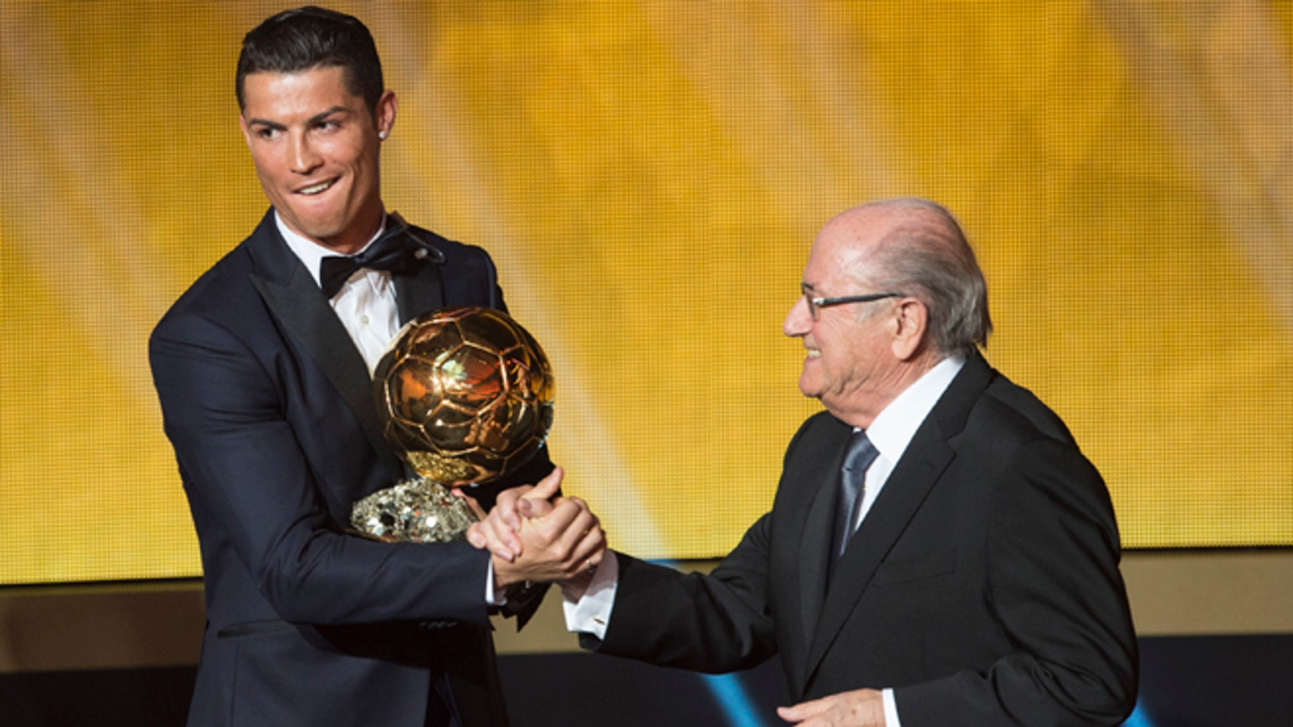 Cristiano Ronaldo congratulated by FIFA President Joseph Blatter the 2014 prize at the FIFA Ballon d'Or.