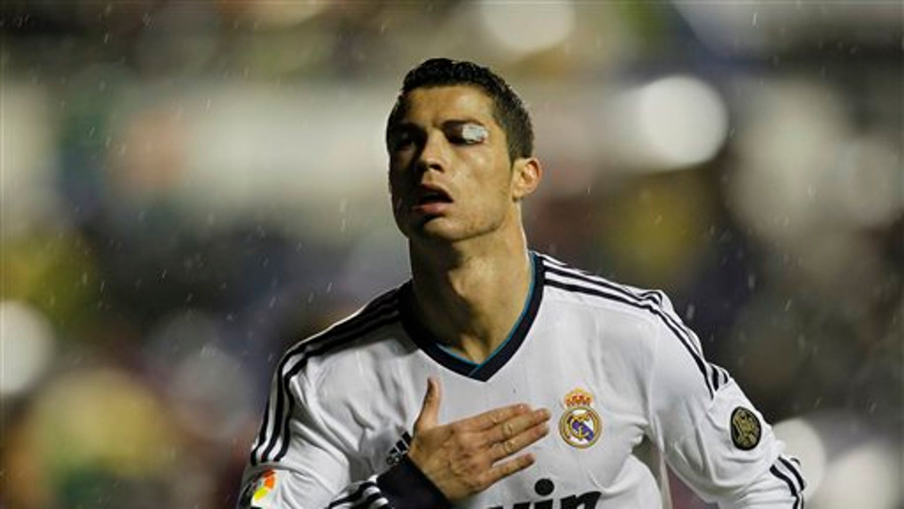 Cristiano Ronaldo's left eye was cut by David Navarro during Real Madrid's match against Levante on Nov. 11, 2012.  (AP Photo/ Fernando Hernández)