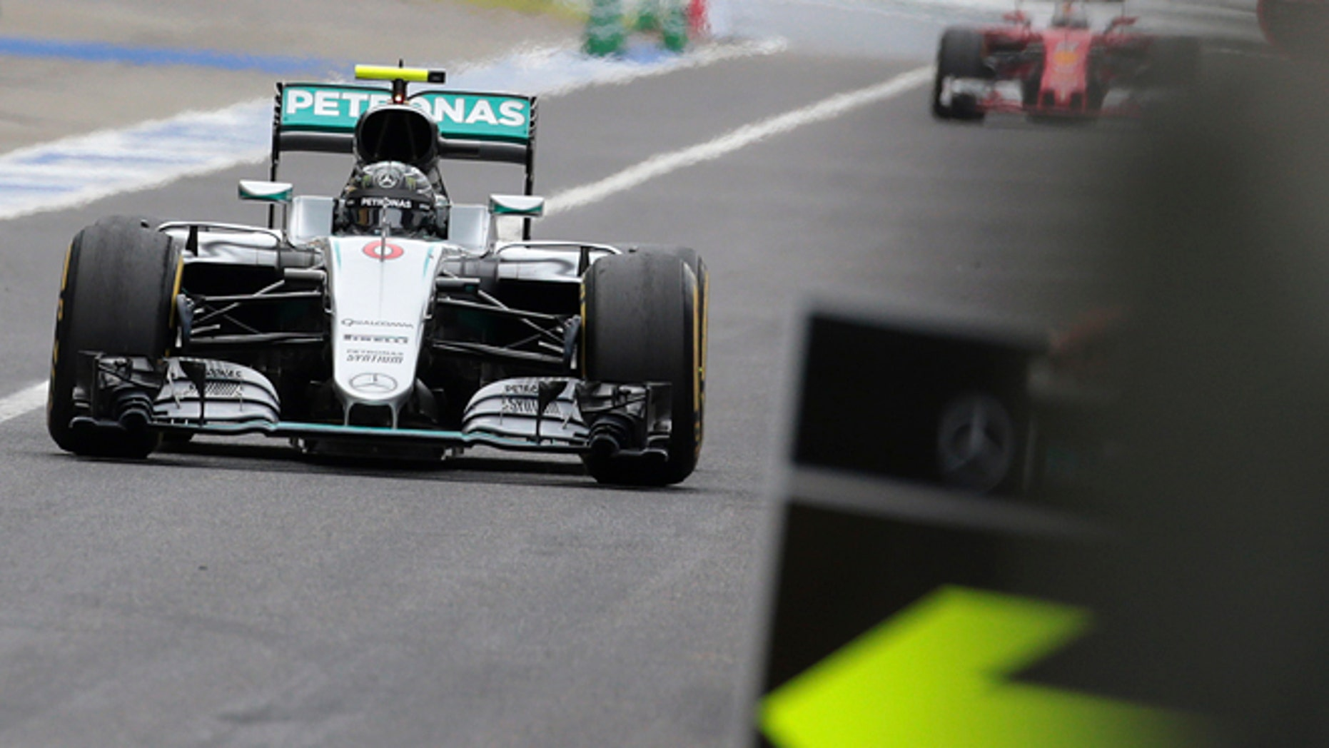 Mercedes driver Nico Rosberg of Germany returns to the pit lane on the way to winning the Japanese Formula One Grand Prix at the Suzuka International Circuit in Suzuka, central Japan, Sunday, Oct. 9, 2016. (Yuya Shino/Pool Photo via AP)