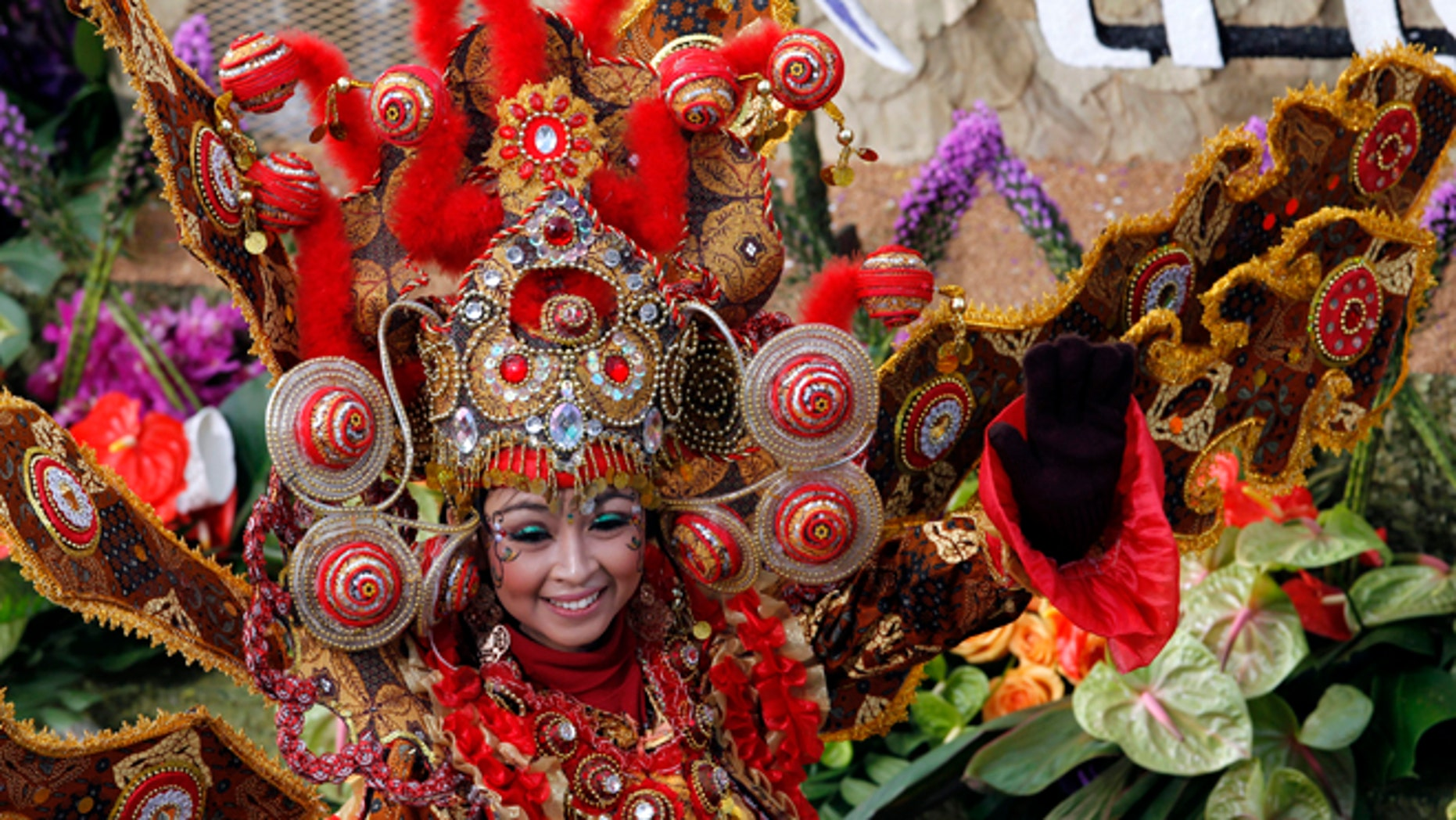 """Jan. 1, 2013: A woman smiles from the float """"Wonderful Indonesia"""" from the Ministry of Tourism and Creative Economies, Republic of Indonesia_the winner of the Presidents trophy for the most innovative use and presentation of flowers in the 124th Rose Parade in Pasadena, Calif."""