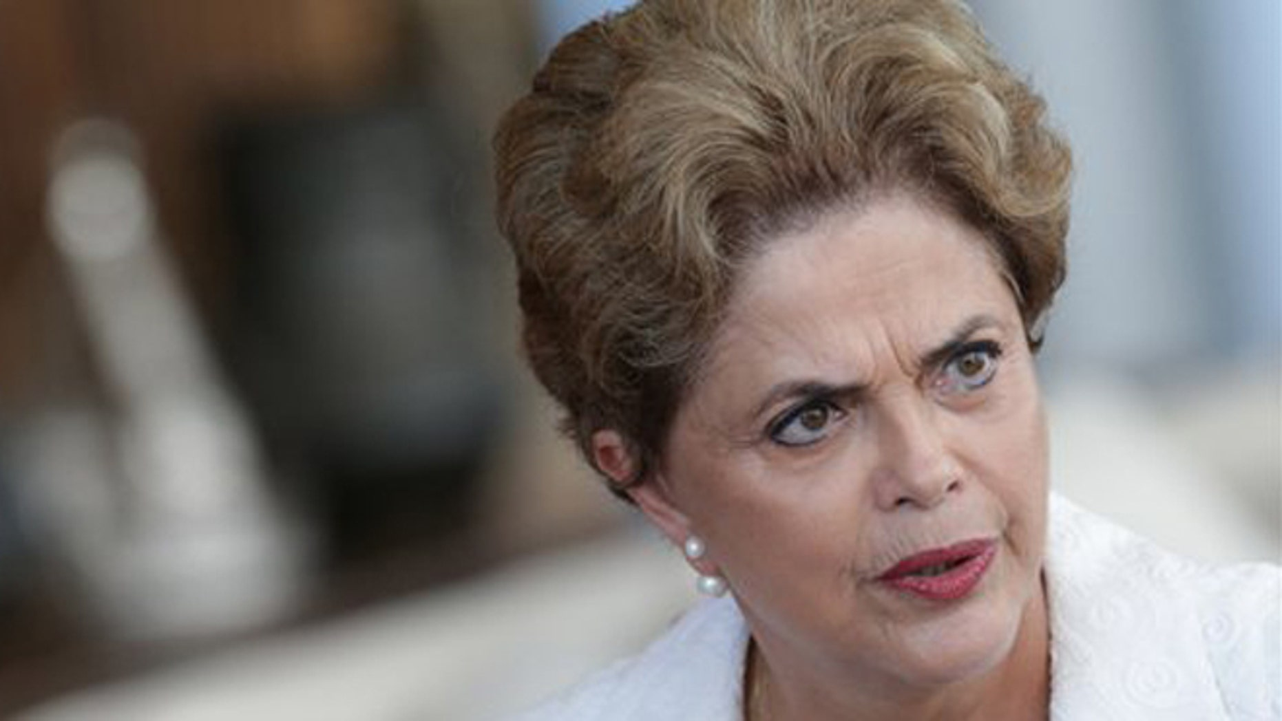 FILE - In this May 13, 2016, file photo, suspended Brazilian President Dilma Rousseff speaks during a press conference with the international press corps, at the presidential residence Alvorada Palace in Brasilia, Brazil. Rousseff was quoted in an interview published on Sunday, May 29, 2016, that her impeachment is aimed at stopping the current corruption investigation against several politicians and businessmen. (AP Photo/Eraldo Peres, File)
