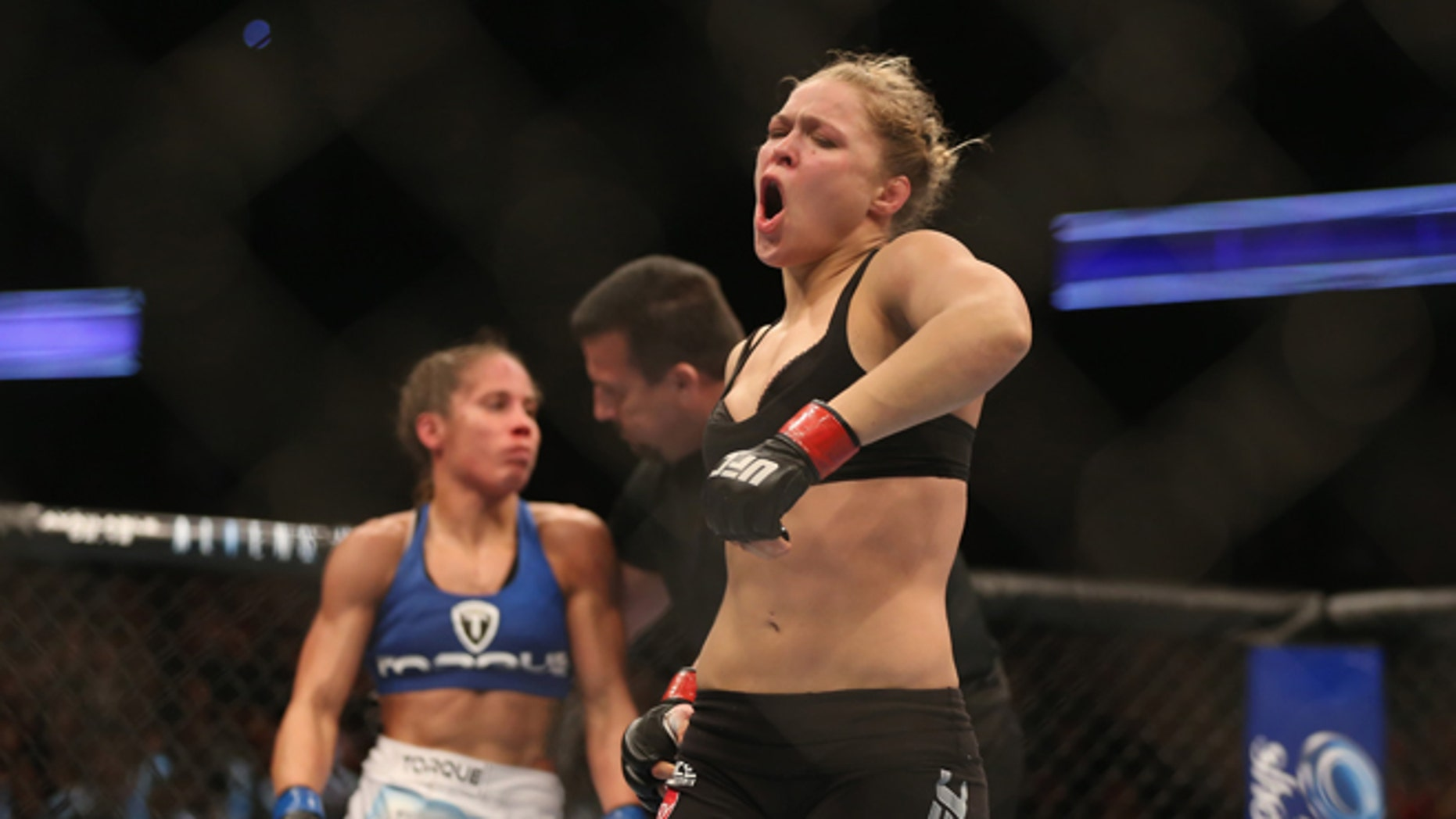 ANAHEIM, CA - FEBRUARY 23:  Ronda Rousey celebrates her UFC Bantamweight Title over Liz Carmouche at Honda Center on February 23, 2013 in Anaheim, California.  (Photo by Jeff Gross/Getty Images)
