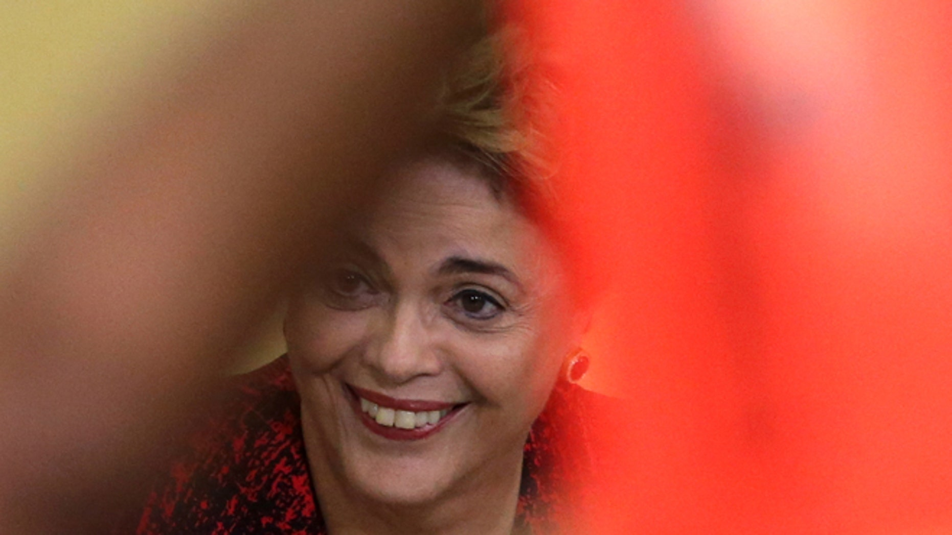 Brazil's President Dilma Rousseff smiles during a ceremony where she announced the opening of new federal universities at Planalto presidential palace in Brasilia, Brazil, Monday, May 9, 2016. The acting speaker of the lower house of Brazil's Congress on Monday annulled last month's vote on impeachment, delaying and complicating the process that was widely expected to see Rousseff suspended later this week.  (AP Photo/Eraldo Peres)