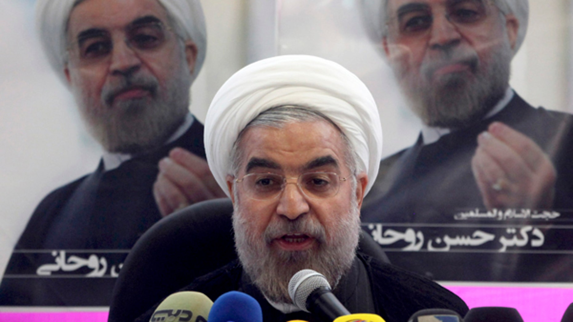 The cabinet assembled by new Iranian President Hasan Rowhani is made up of 18 mostly hard-liners. (AP Photo/Vahid Salemi)