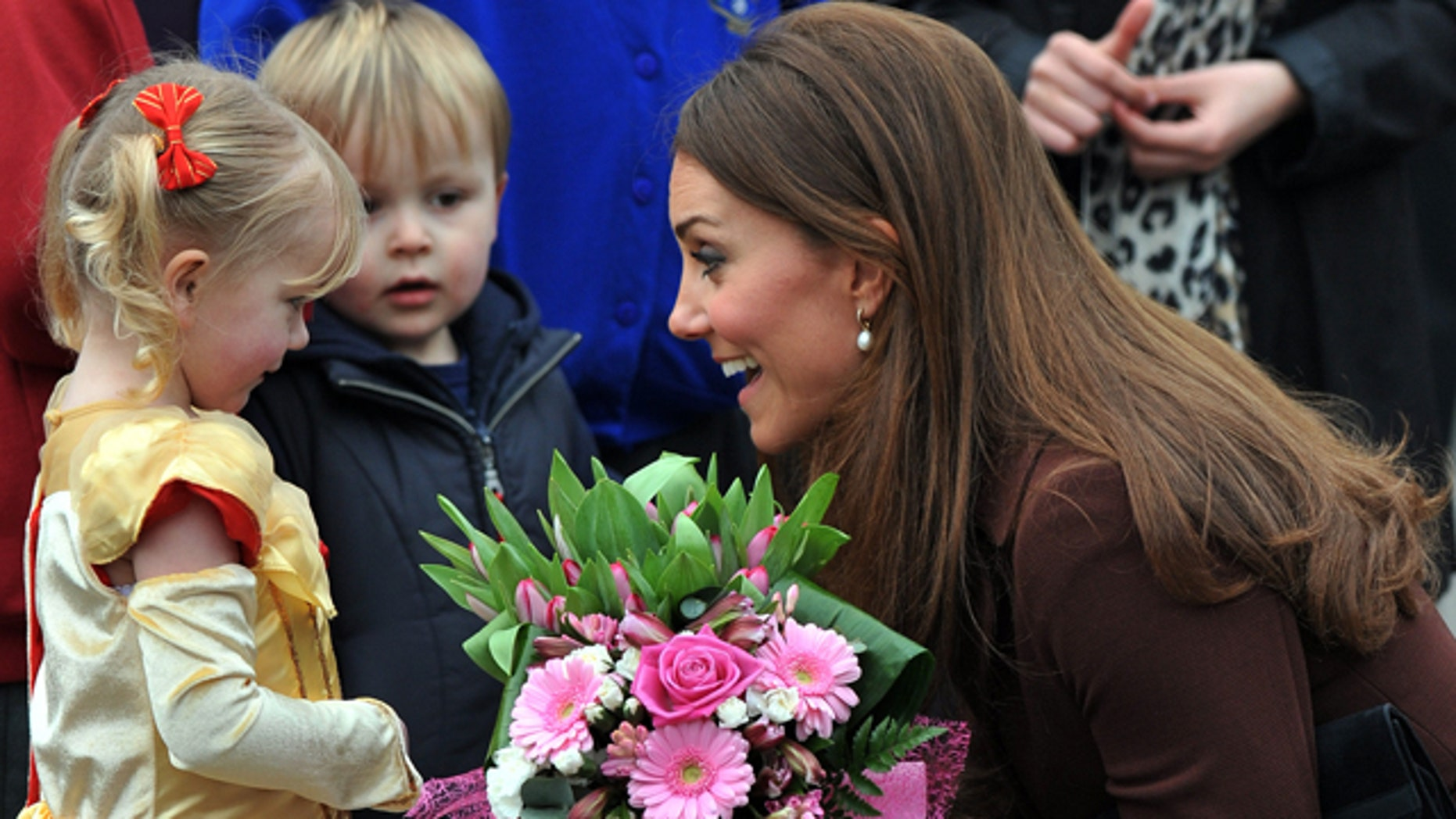 Mar. 5, 2013: Britain's Catherine, Duchess of Cambridge receives flowers from 3-year old Isobelle Laursen, left, during her visit to Humberside Fire and Rescue Station.