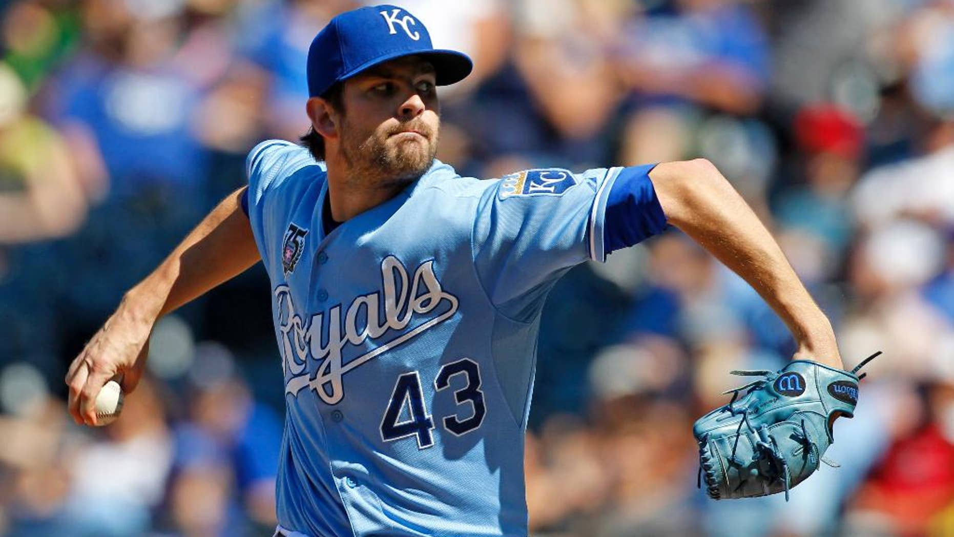 FILE - In this July 27, 2014, file photo, Kansas City Royals relief pitcher Aaron Crow throws to a batter in the ninth inning of a baseball game against the Cleveland Indians at Kauffman Stadium in Kansas City, Mo. The former first-round draft pick was traded Friday, Nov. 28, 2014, from the Royals to the Miami Marlins for left-hander Brian Flynn and right-hander Reid Redman.  (AP Photo/Colin E. Braley, File)