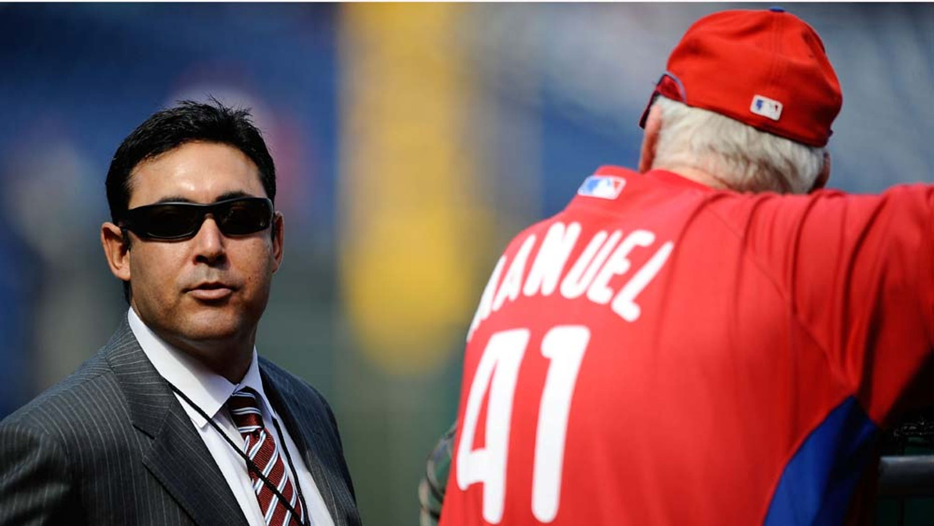 PHILADELPHIA - OCTOBER 08:  General Manager Ruben Amaro Jr. of the Philadelphia Phillies talks with Phillies manager Charlie Manuel #41 on the field during batting practice prior to Game Two of the NLDS against the Colorado Rockies during the 2009 MLB Playoffs at Citizens Bank Park on October 8, 2009 in Philadelphia, Pennsylvania.  (Photo by Jeff Zelevansky/Getty Images)