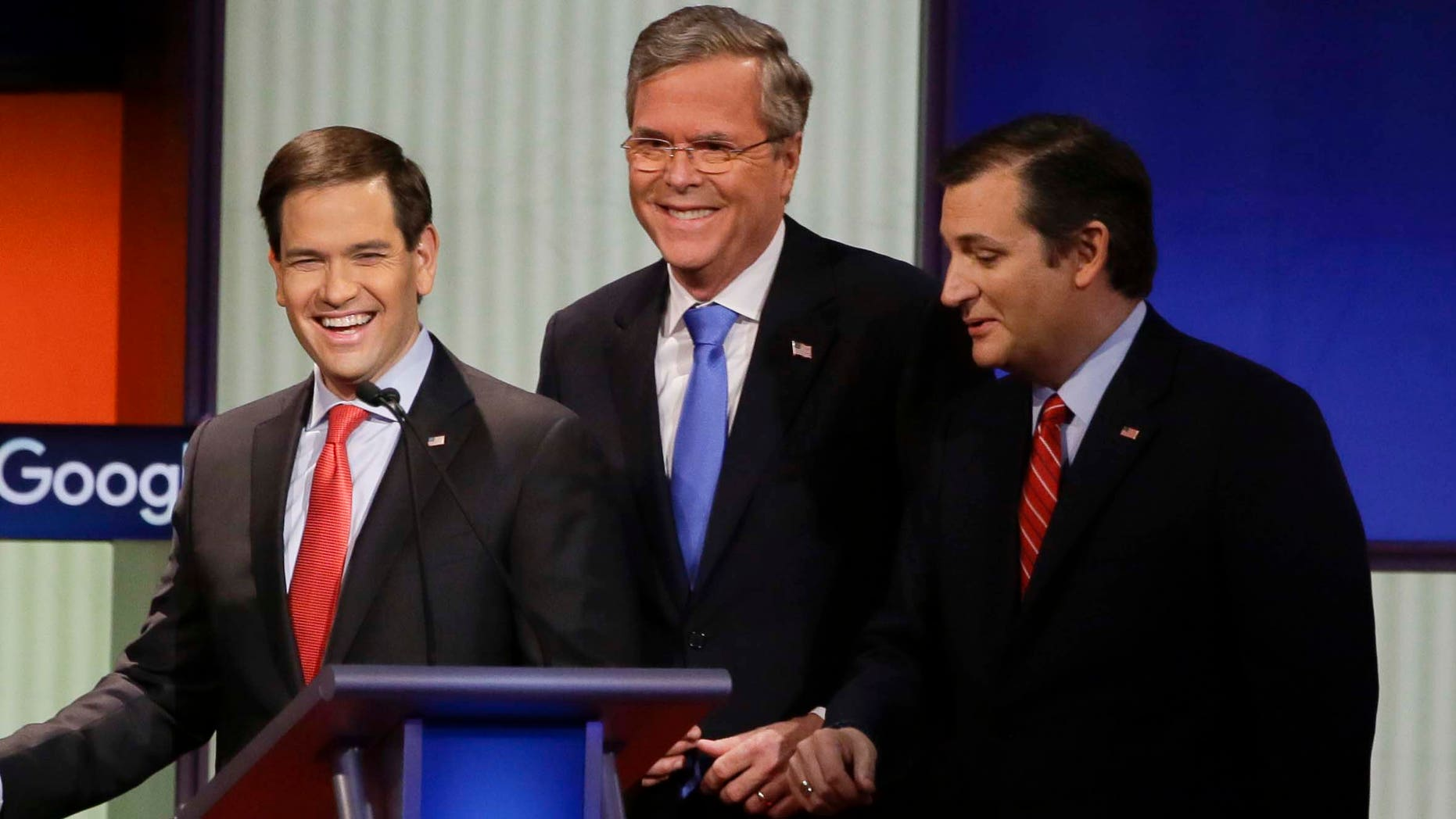 Republican presidential candidates (L-R) New Jersey Gov. Chris Christie, Sen. Marco Rubio, R-Fla., former Florida Gov. Jeb Bush and Sen. Ted Cruz, R-Texas, talk after the Republican presidential primary debate, Thursday, Jan. 28, 2016, in Des Moines, Iowa. (AP Photo/Charlie Neibergall)