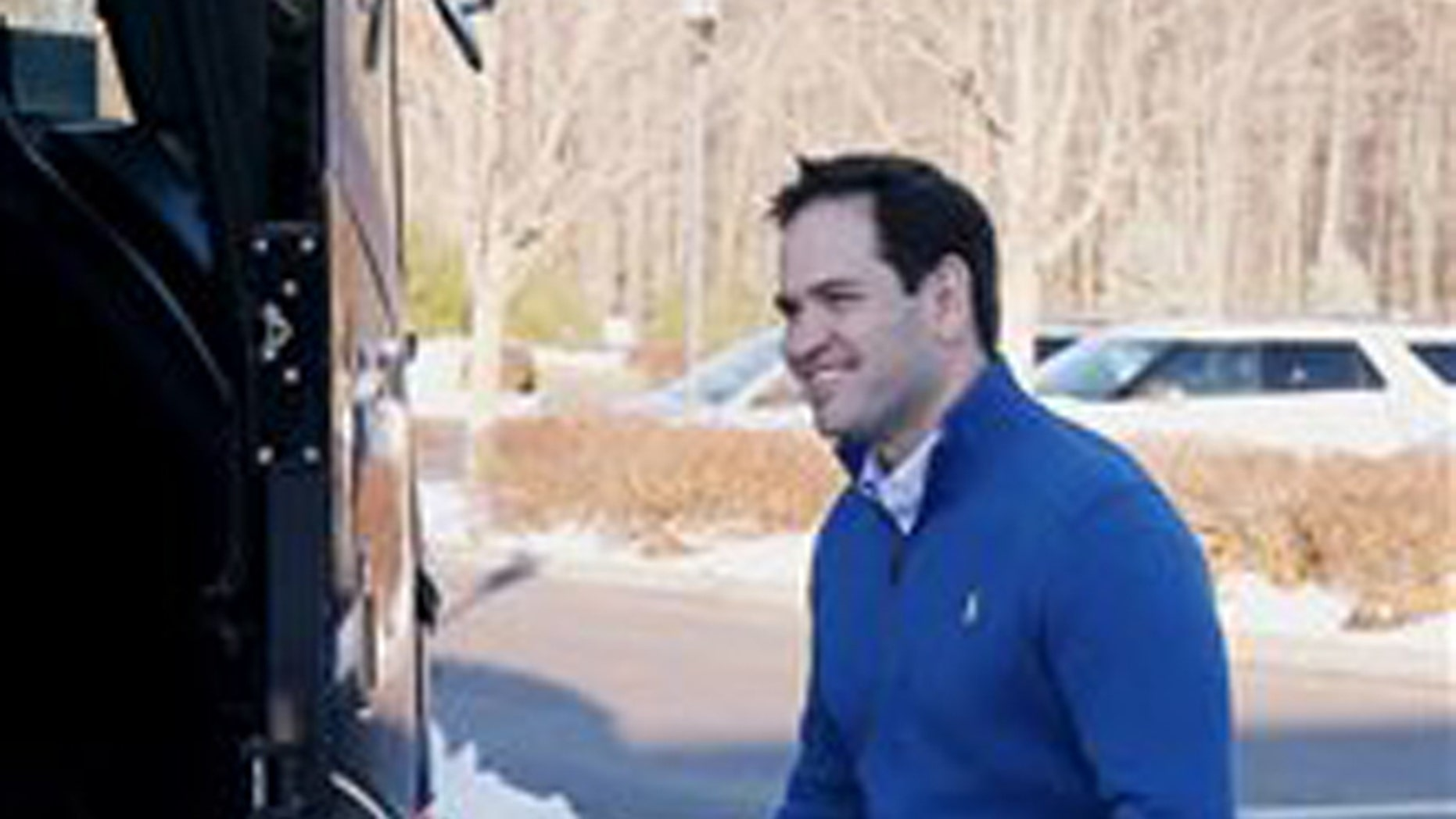 Republican presidential candidate Sen. Marco Rubio, R-Fla., steps into his campaign bus after a stop at the Atkinson Country Club, Sunday, Jan. 3, 2016, in Atkinson, N.H. (AP Photo/Mary Schwalm)