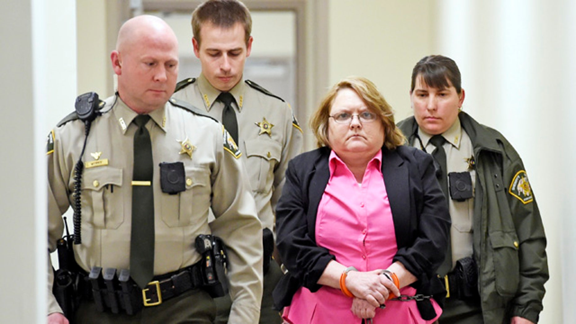 FILE - In this March 20, 2015, file photo, Joyce Hardin Garrard is led back to the Etowah County Detention Center in Gadsden, Ala. (Eric T. Wright/The Gadsden Times via AP, File)