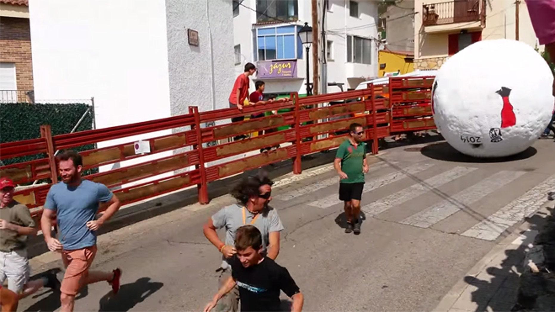 The Running of the Balls in Mataelpino, Spain. (Photo: Via YouTube)