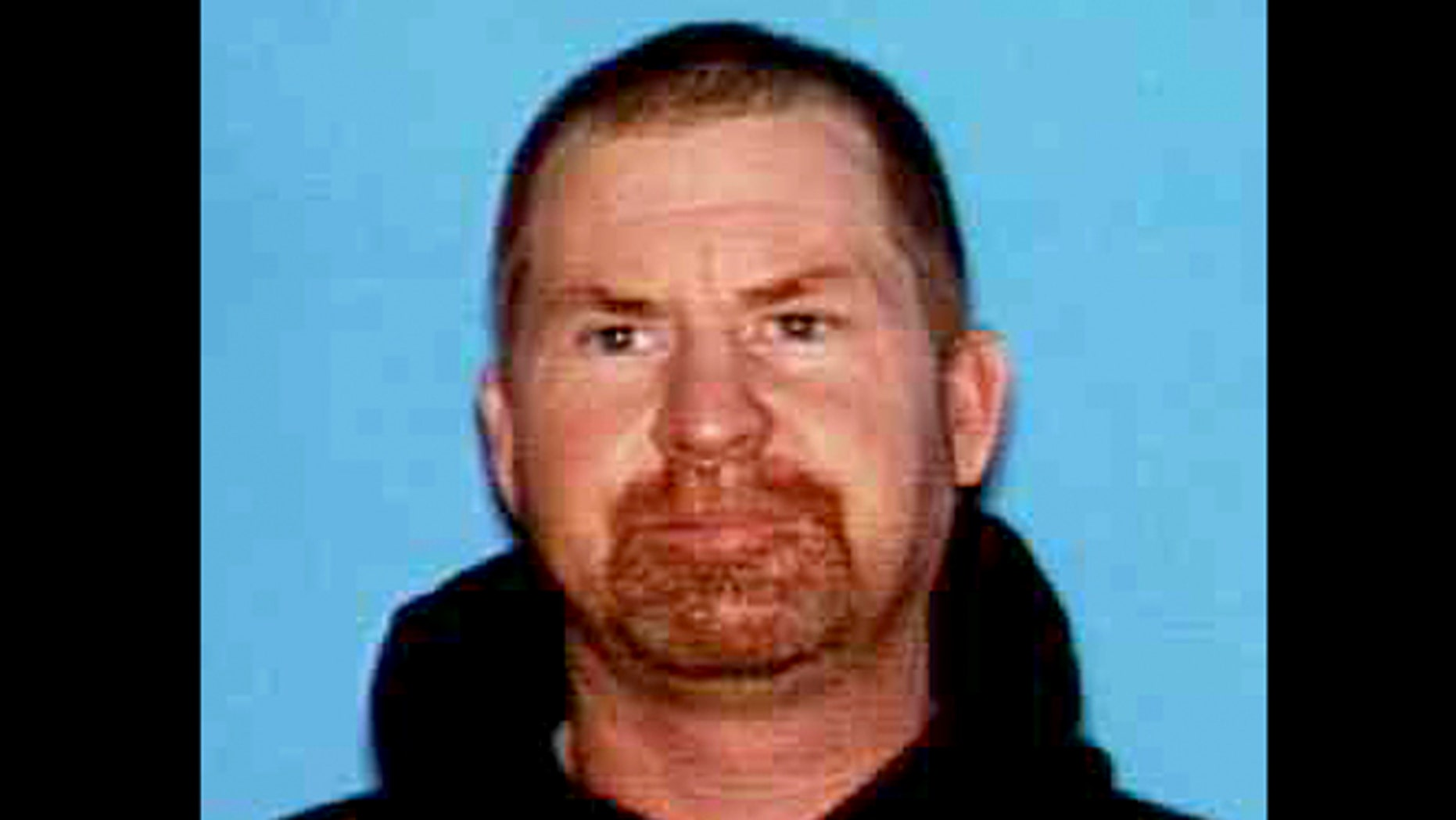 This undated photo released by the Shasta County Sheriff's office shows Shane Miller, 45, who is suspected of a triple homicide at his home in rural Northern California.