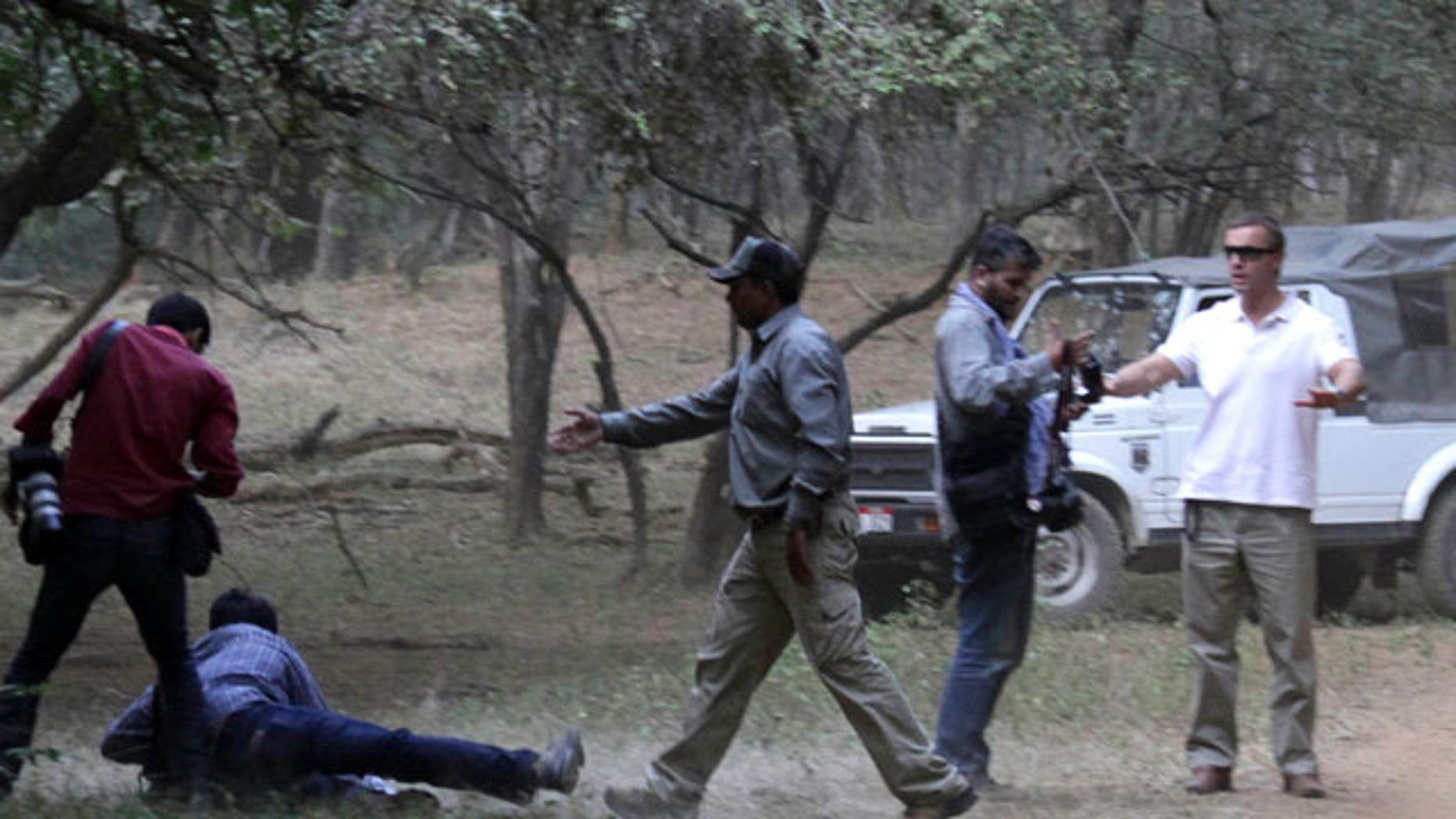 Oct. 22: An AP photographer captured images of an altercation between Brand's entourage and photographers in India.