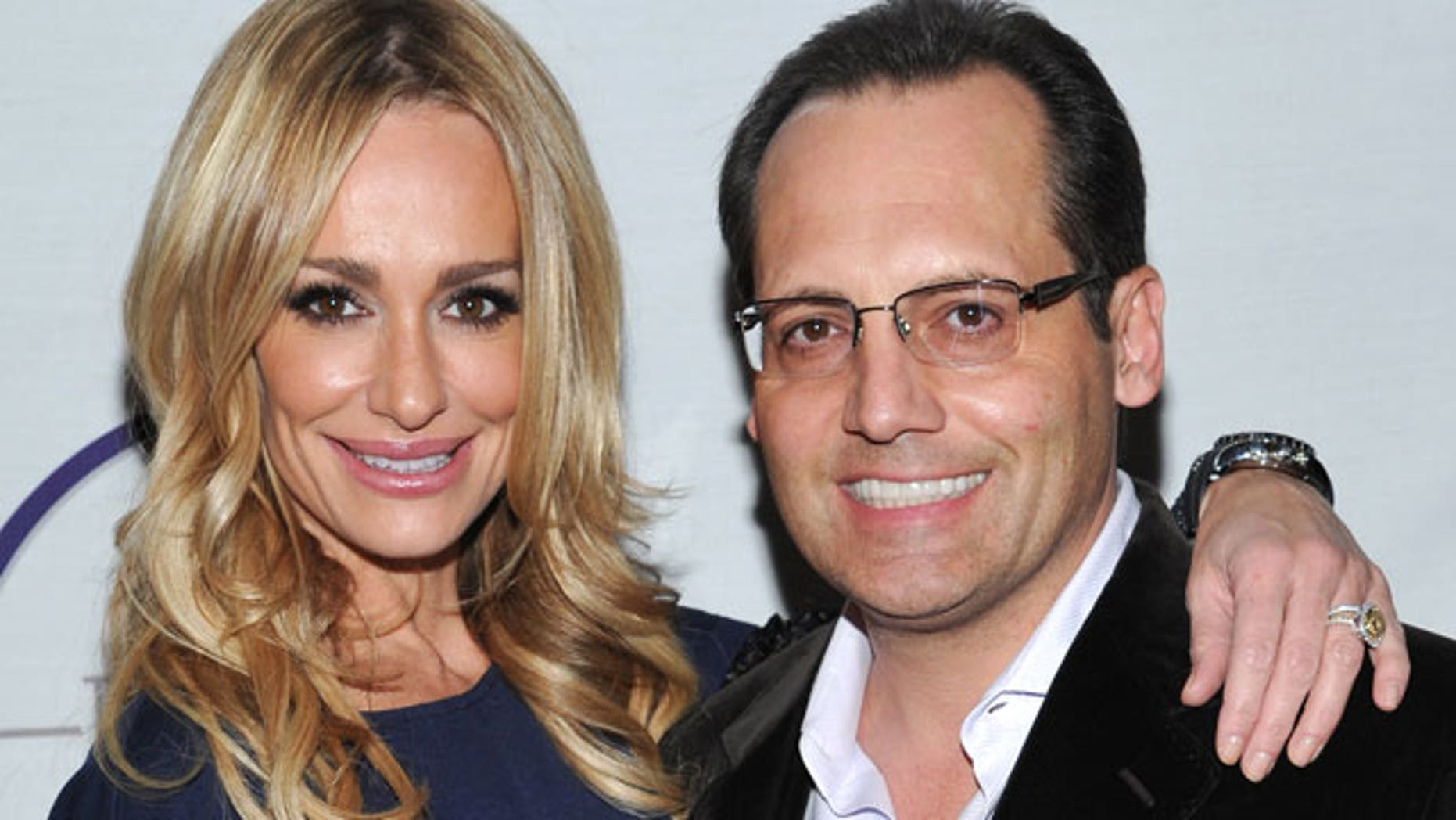 Taylor Armstrong and her late husband Russell Armstrong, who was found dead of an apparent suicide. (AP)