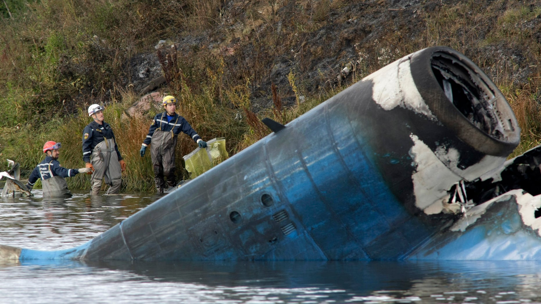 Sept. 7, 2011: Rescuers work at the crash site of a Russian Yak-42 jet near the city of Yaroslavl, on the Volga River about 150 miles northeast of Moscow, Russia.