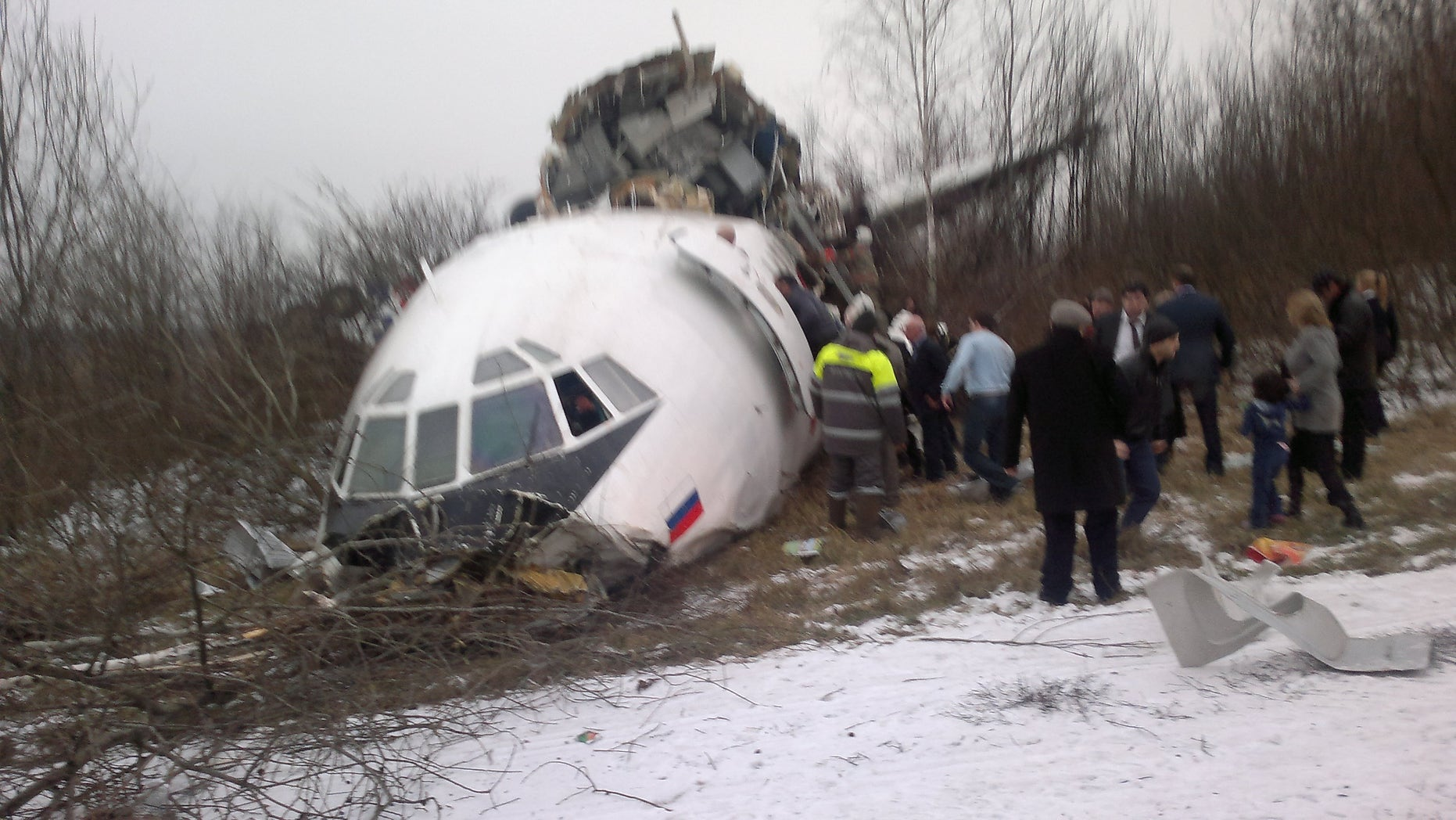 In this photo taken on a cell phone by an eyewitness, showing a Tupolev Tu-154 passenger jet belonging to Dagestan Airlines is seen after an emergency landing on Saturday, Dec. 4, 2010, at Moscow Domodedovo aiport. The passenger jet with 155 people aboard skidded off the runway during an emergency landing at the Moscow airport on Saturday, killing two people and injuring some dozens of others, Russian officials said, after all of its three engines failed.