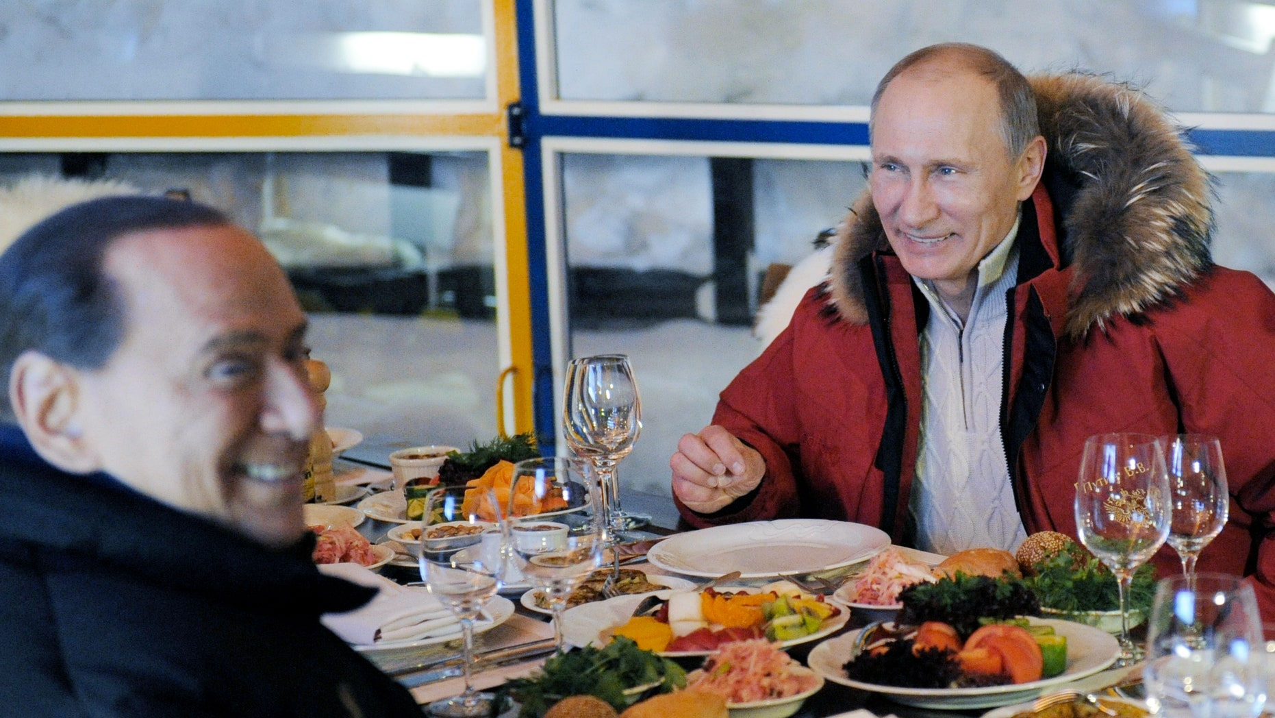 Mar. 7, 2012: Former Italian Prime Minister Silvio Berlusconi, left, and Russian Prime Minister Vladimir Putin, right, smile during their meeting in the mountain resort of Krasnaya Polyana near the Black Sea resort of Sochi, southern Russia.