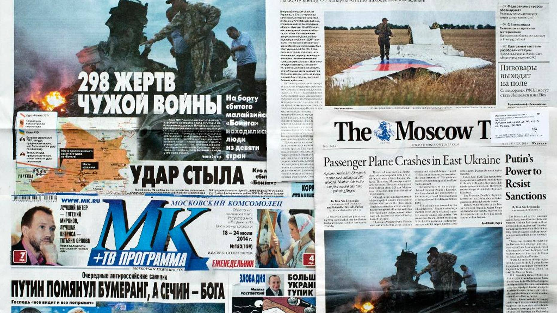 "This June 20, 2014 file photo, shows a combination of images of Russian nationwide weekend dailies' front pages on downed Malaysia Airlines Flight 17 in Moscow Russia, some of them reading ""298 Victims of Someone Else's War,"" and ""Kick From Behind."" An assassination attempt against Russian President Vladimir Putin. A desperate ploy to draw the West into the battle for Ukraine's east. A botched mission to commit mass-murder against Russian citizens. Russian news consumers are getting plenty of explanations for the downing of Malaysian Airlines Flight 17, which killed 298 people."
