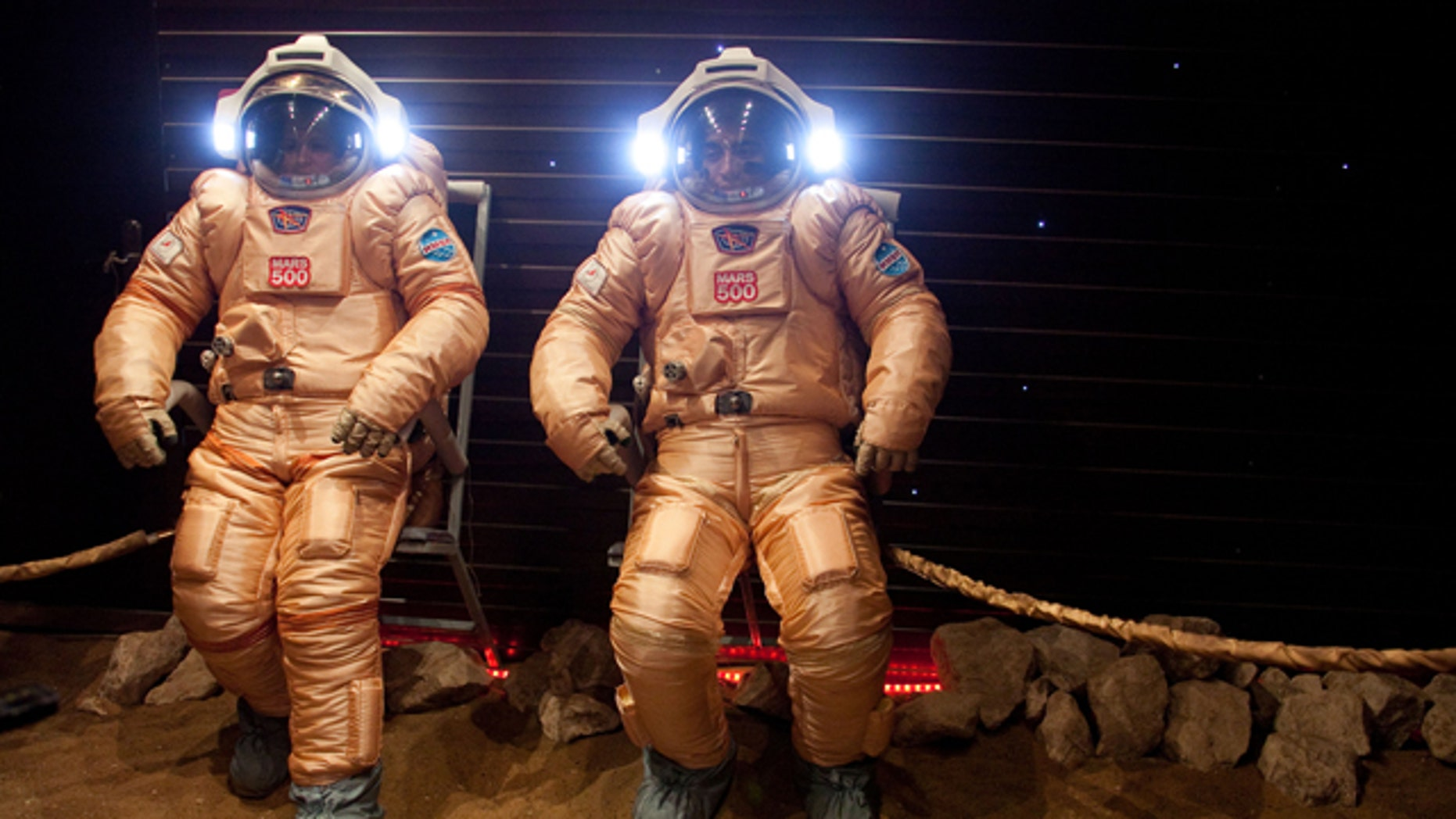 May 24, 2010: Researchers test spacesuits on a simulated Mars surface during a training session at Moscow's Institute for Medical and Biological Problems.