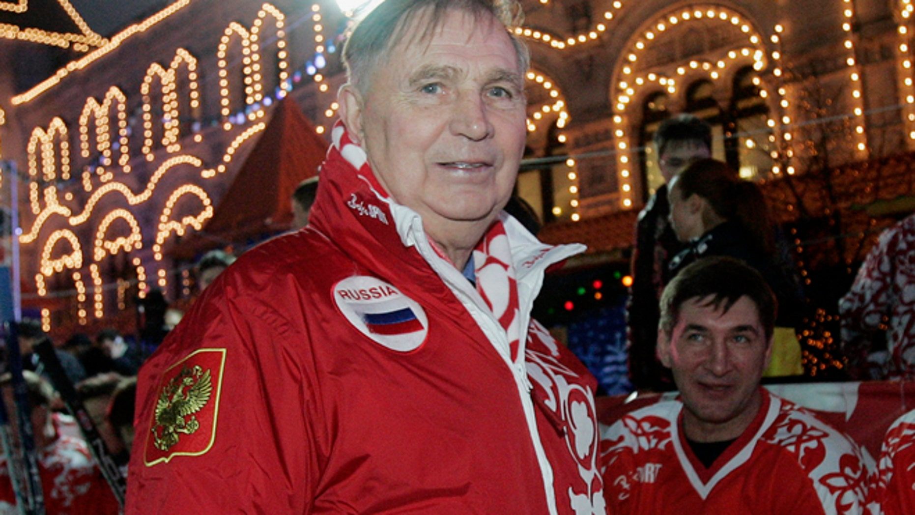 """Dec. 9, 2006: In this file photo, Legendary Soviet ice hockey coach Viktor Tikhonov, centre, stands at the """"Team USSR"""" bench prior to the charity ice hockey match, at the Moscow's Red Square. (AP)"""