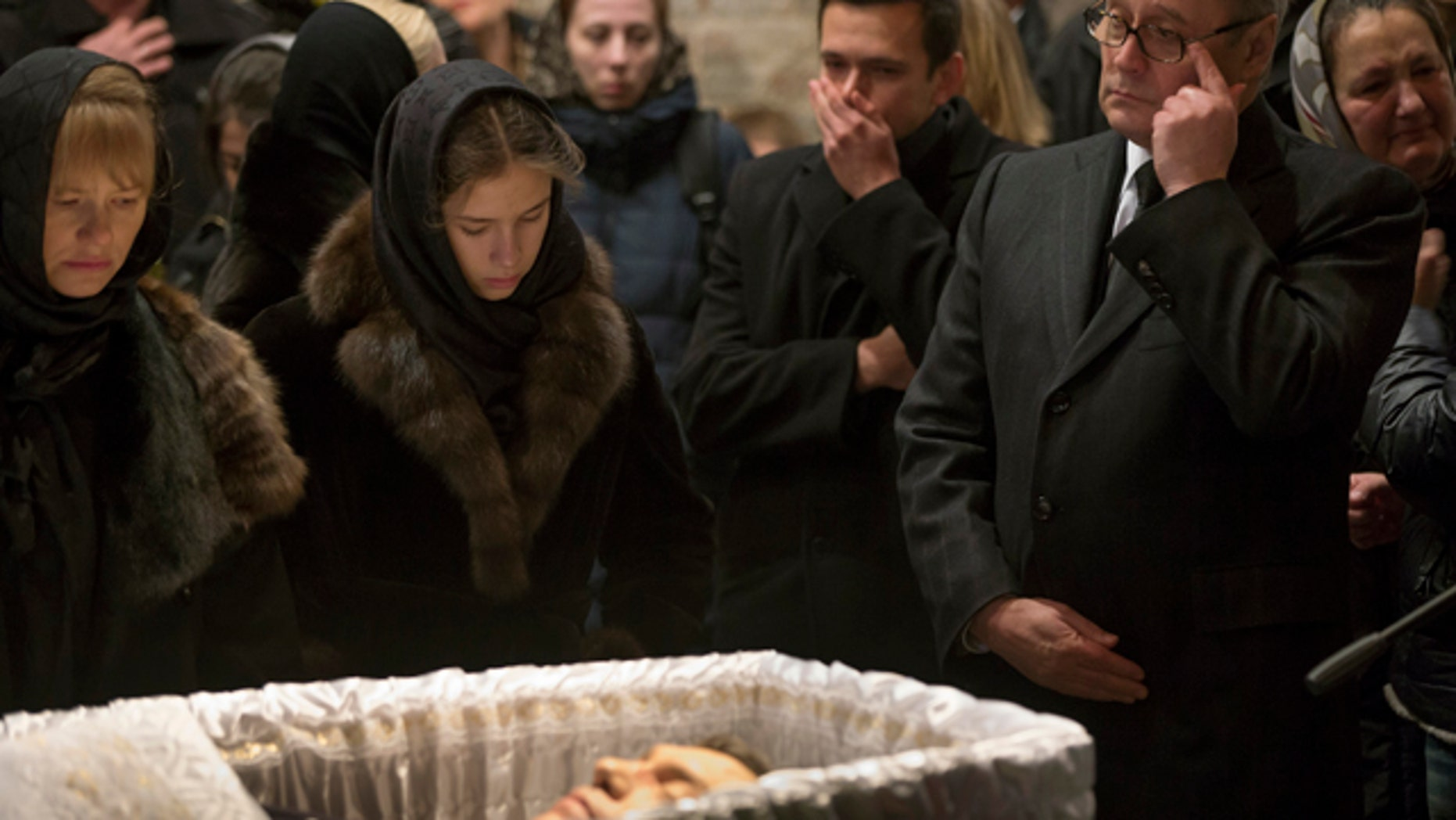 March 3, 2015: Opposition leaders, former Russian Prime Minister Mikhail Kasyanov, right, and Ilya Yashin, second right, and other relatives and friends pay their last respects by the coffin of Boris Nemtsov, a charismatic Russian opposition leader and sharp critic of President Vladimir Putin, during a farewell ceremony inside the Sakharov center in Moscow. (AP Photo/Pavel Golovkin)