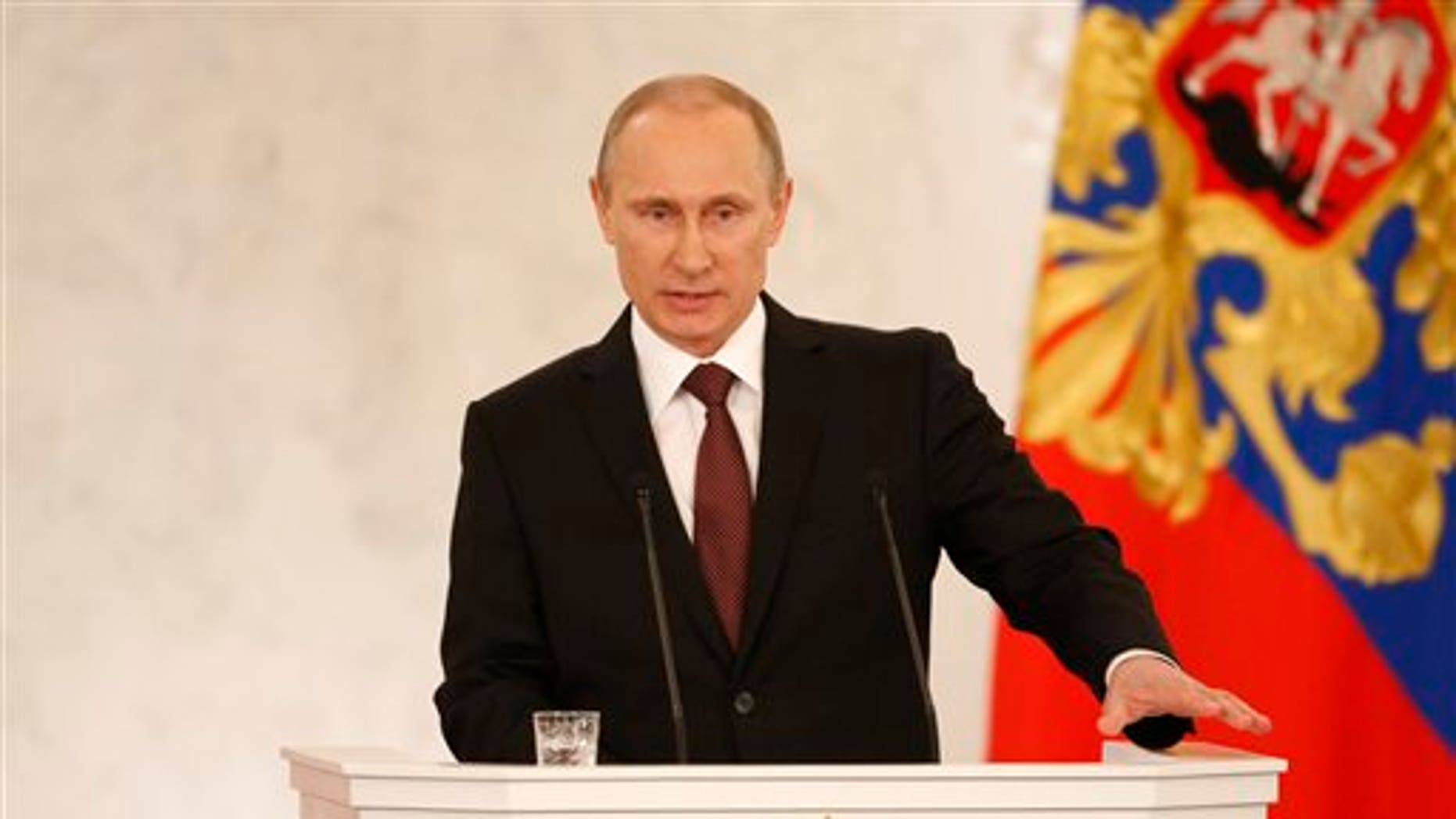 Russia's President Vladimir Putin addresses the Federation Council in Moscow's Kremlin on Tuesday, March 18, 2014.