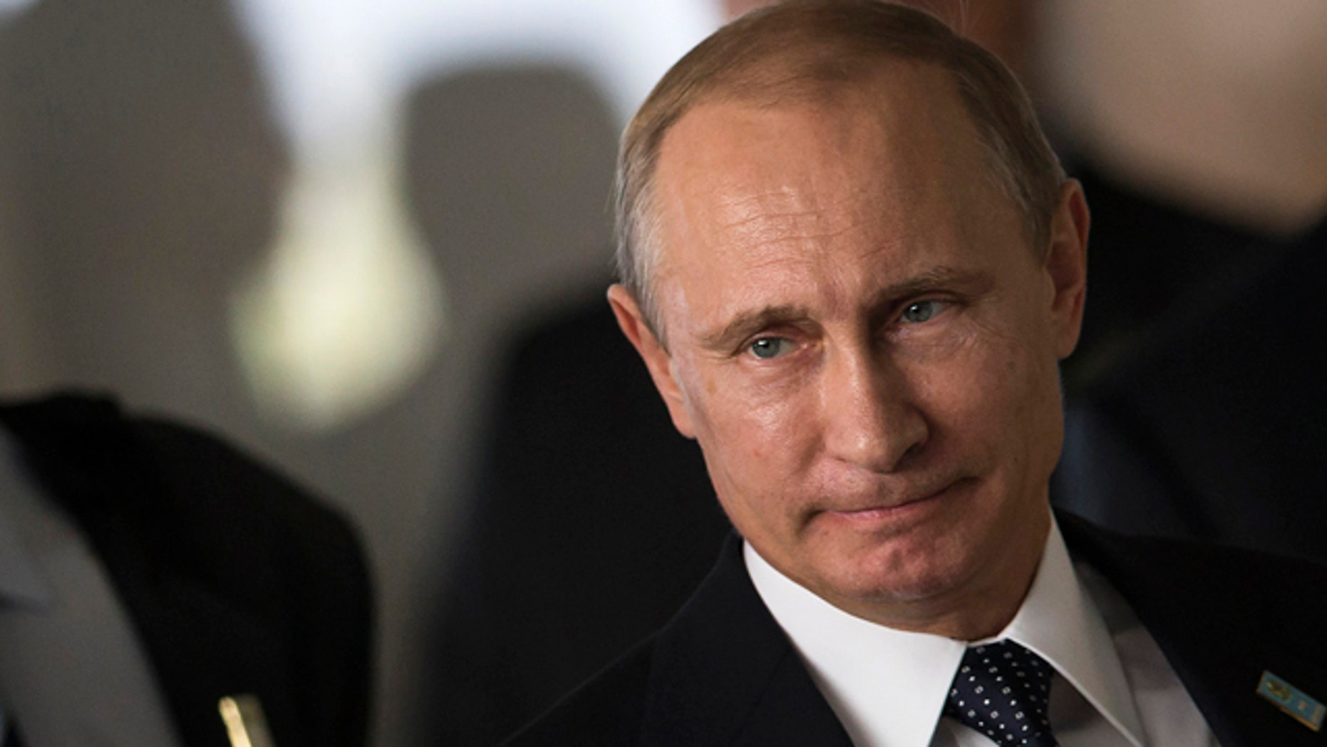 July 16, 2014: Russia's President Vladimir Putin arrives for an official group photo during the BRICS summit at the Itamaraty palace, in Brasilia, Brazil. (AP Photo/Felipe Dana, File )