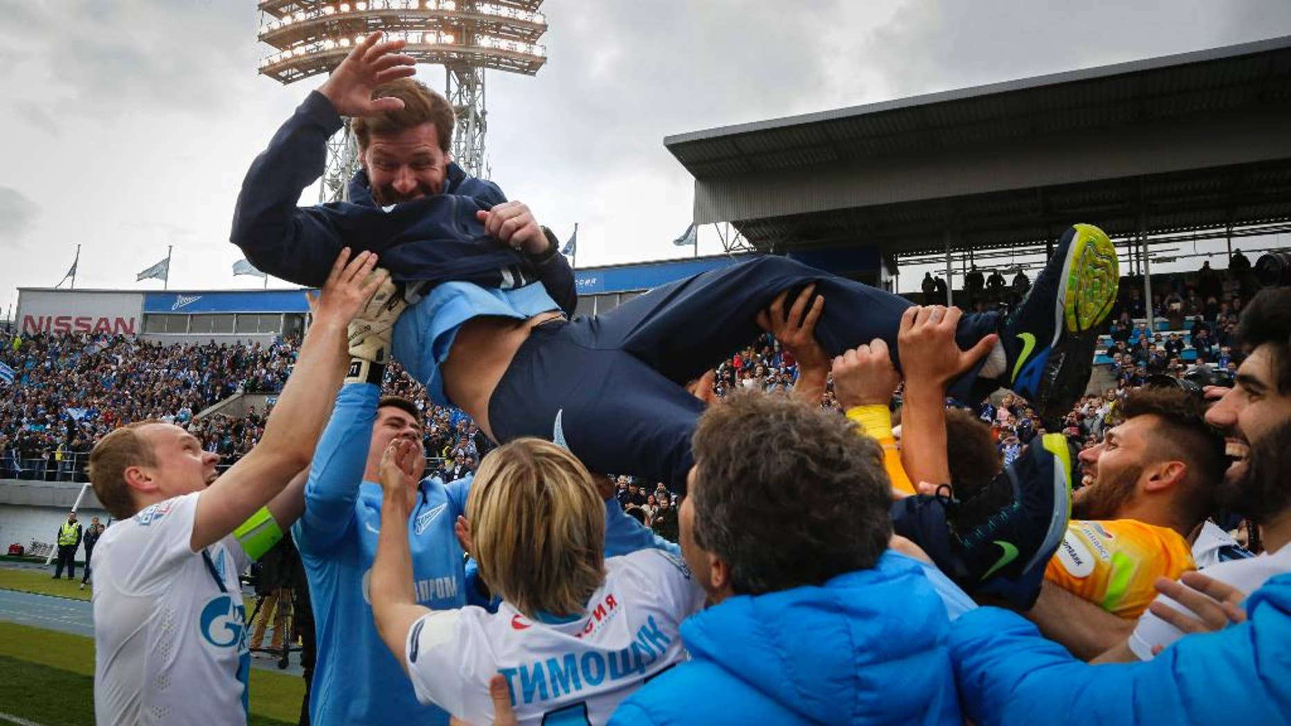 Zenit's players throw Zenit's head coach Andre Villas-Boas as they celebrate after winning the national soccer Championship after match against Ufa in St.Petersburg, Russia, Sunday, May 17, 2015. (AP Photo/Dmitry Lovetsky)
