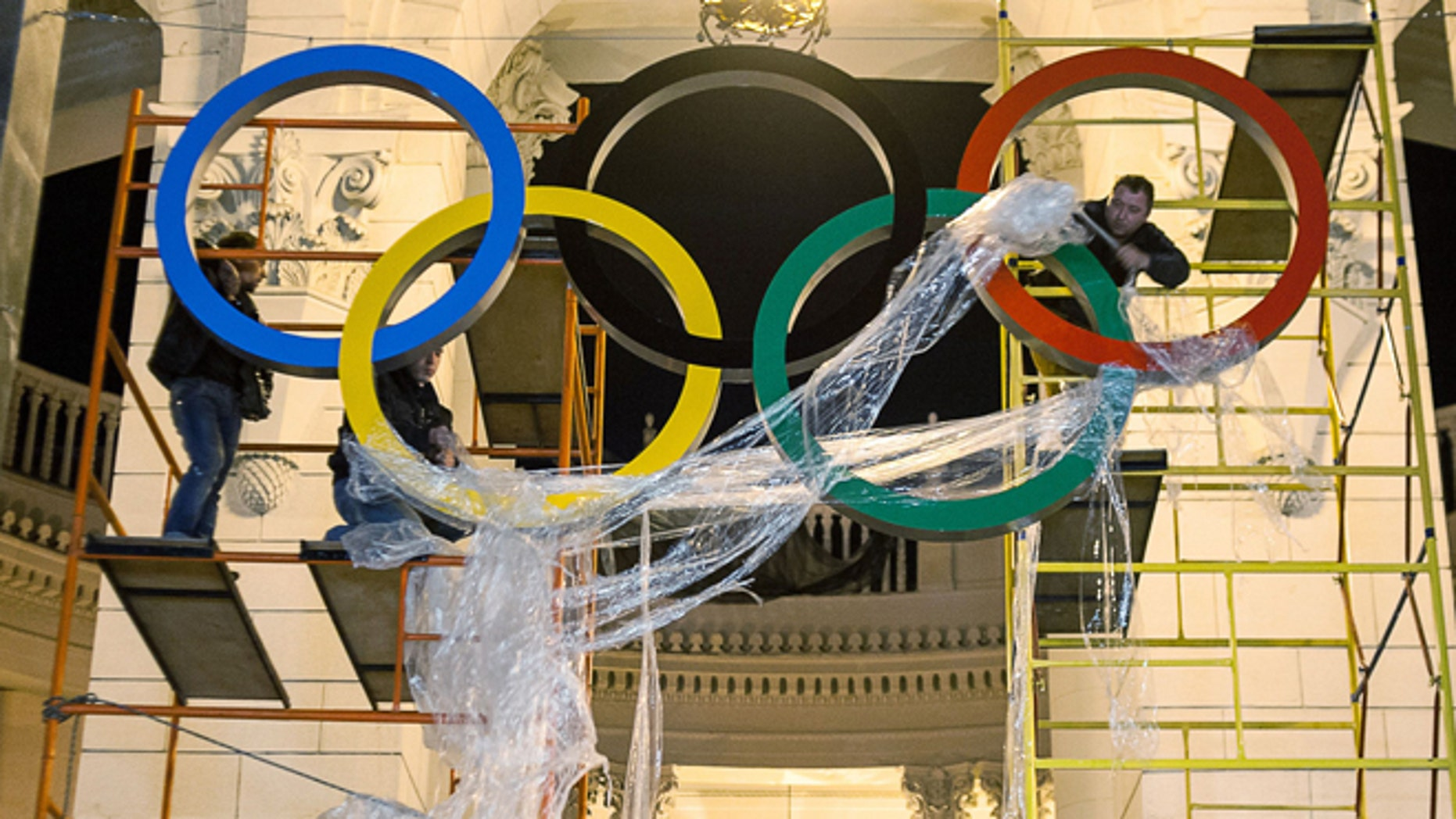 Oct. 28, 2013: Workers are fixing the Olympic emblem at an entrance to the railway station of Russia's Black Sea resort of Sochi, Russia.