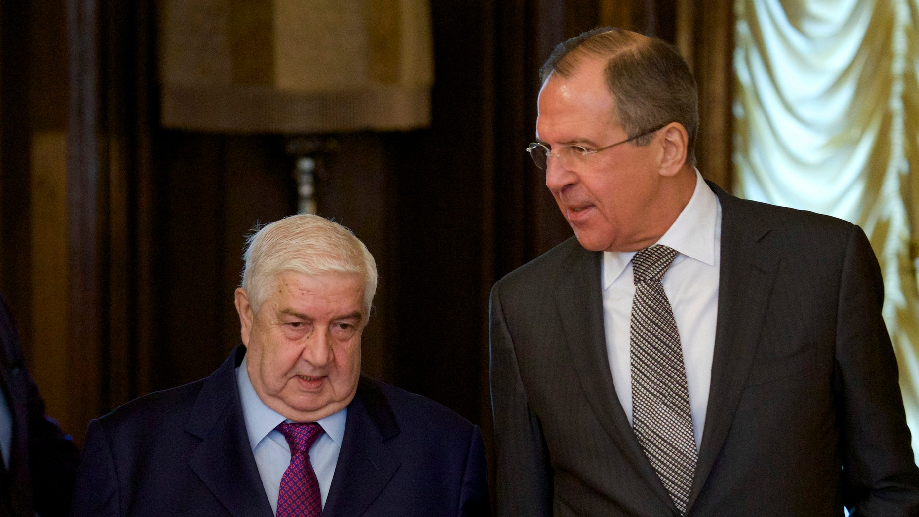 Feb. 25, 2013 - Russian Foreign Minister Sergey Lavrov, right, welcomes Syrian Foreign Minister Walid al-Moallem, left, in Moscow.