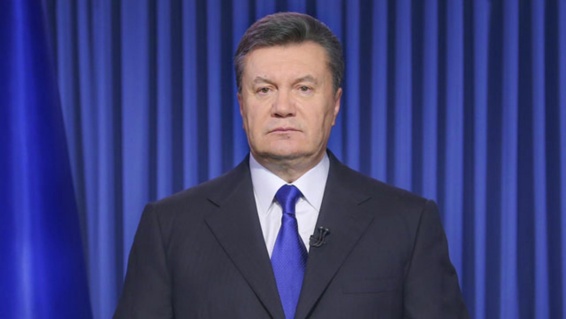 File- This Feb. 19, 2014, file photo shows Ukrainian President Viktor Yanukovych addressing the nation on a live TV broadcast in Kiev, Ukraine. (AP)