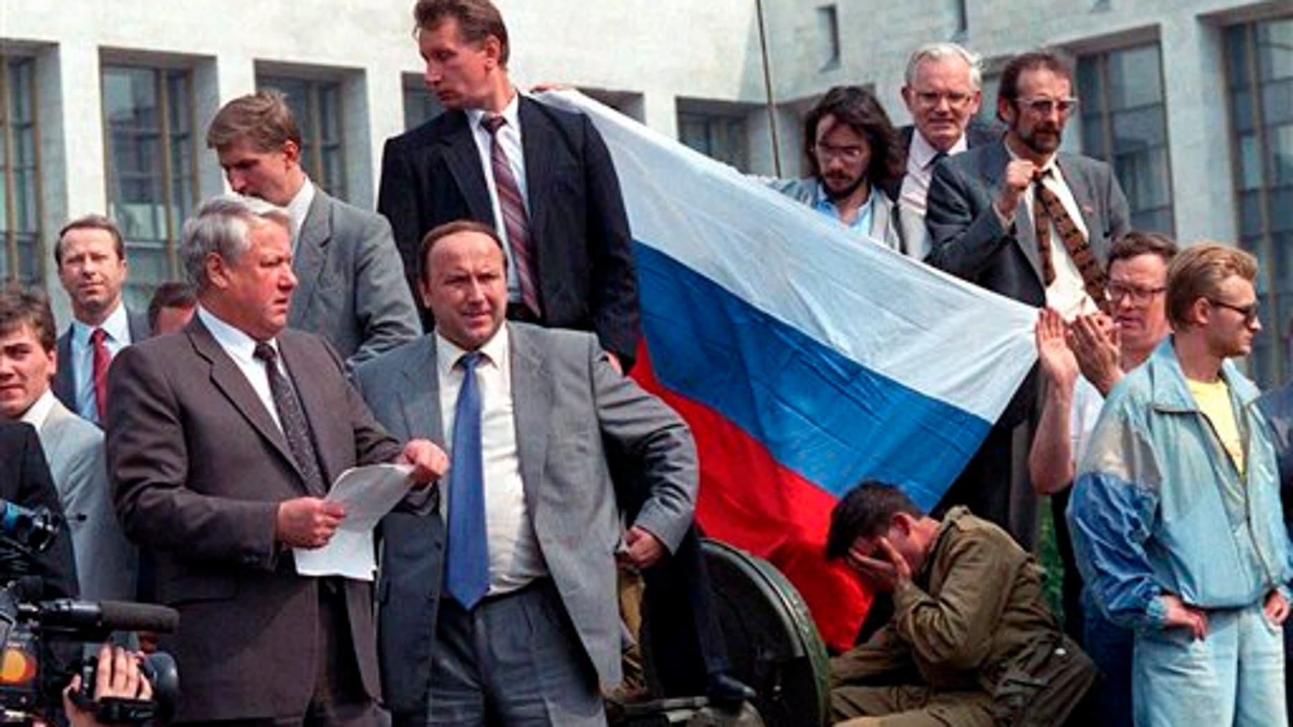 Aug. 19, 1991: Boris Yeltsin, president of Russian Federation, left, reads a statement from atop a tank in Moscow as he urges the Russian people to resist a hardline takeover of the central government.