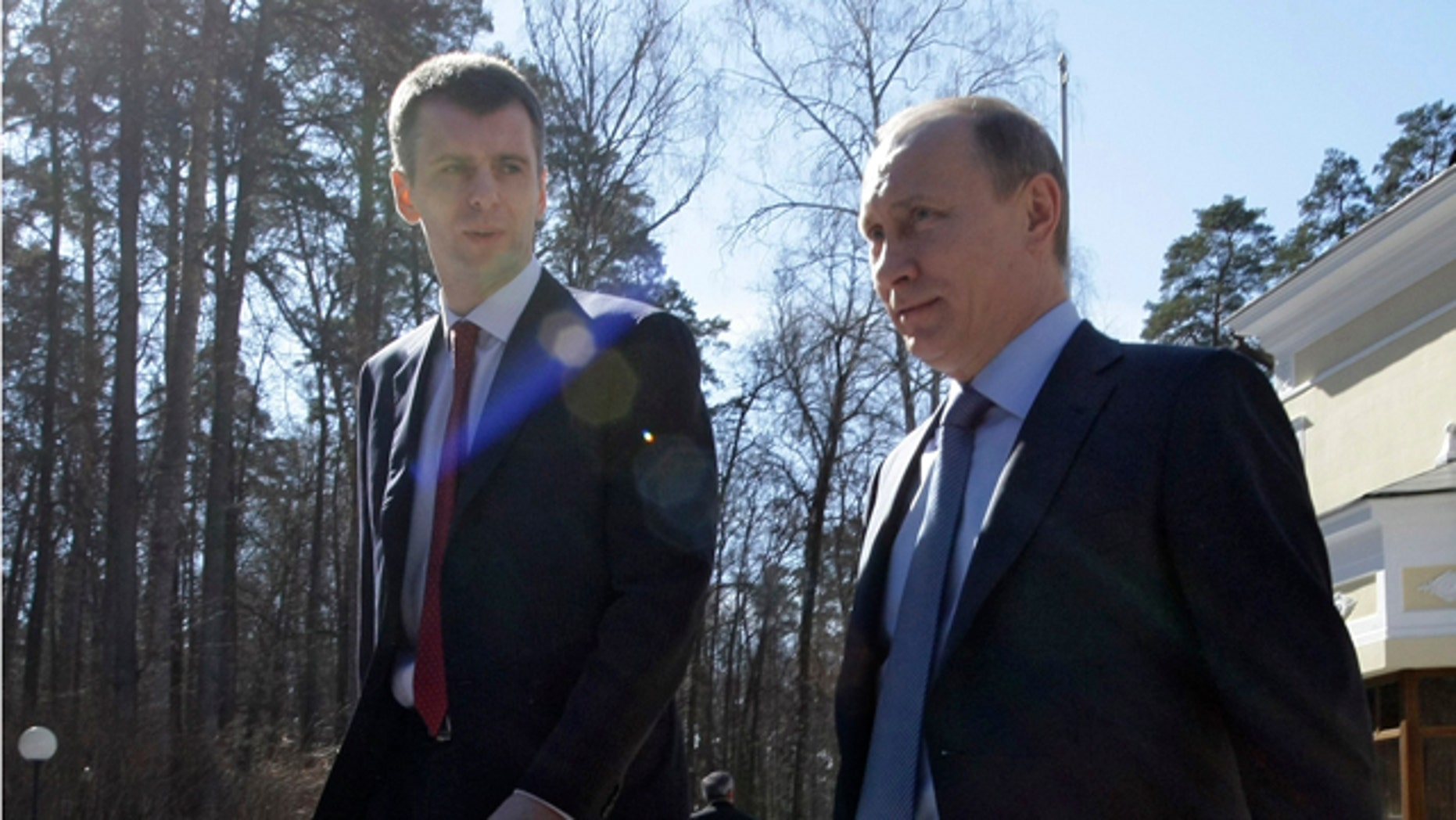 April 2011: Russian Prime Minister Vladimir Putin, right, flanked by Russian billionaire Mikhail Prokhorov at the Gorki residence outside Moscow.
