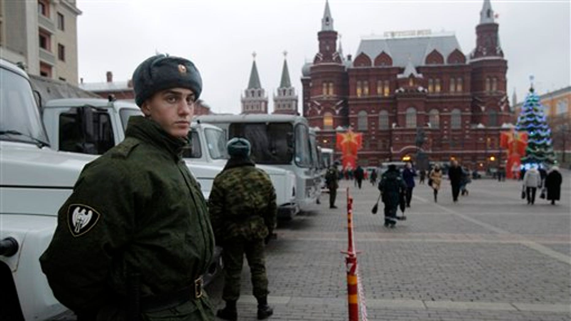 Dec. 9: Russian police troops patrol near Red Square in central Moscow ahead of a massive opposition rally scheduled for Saturday.